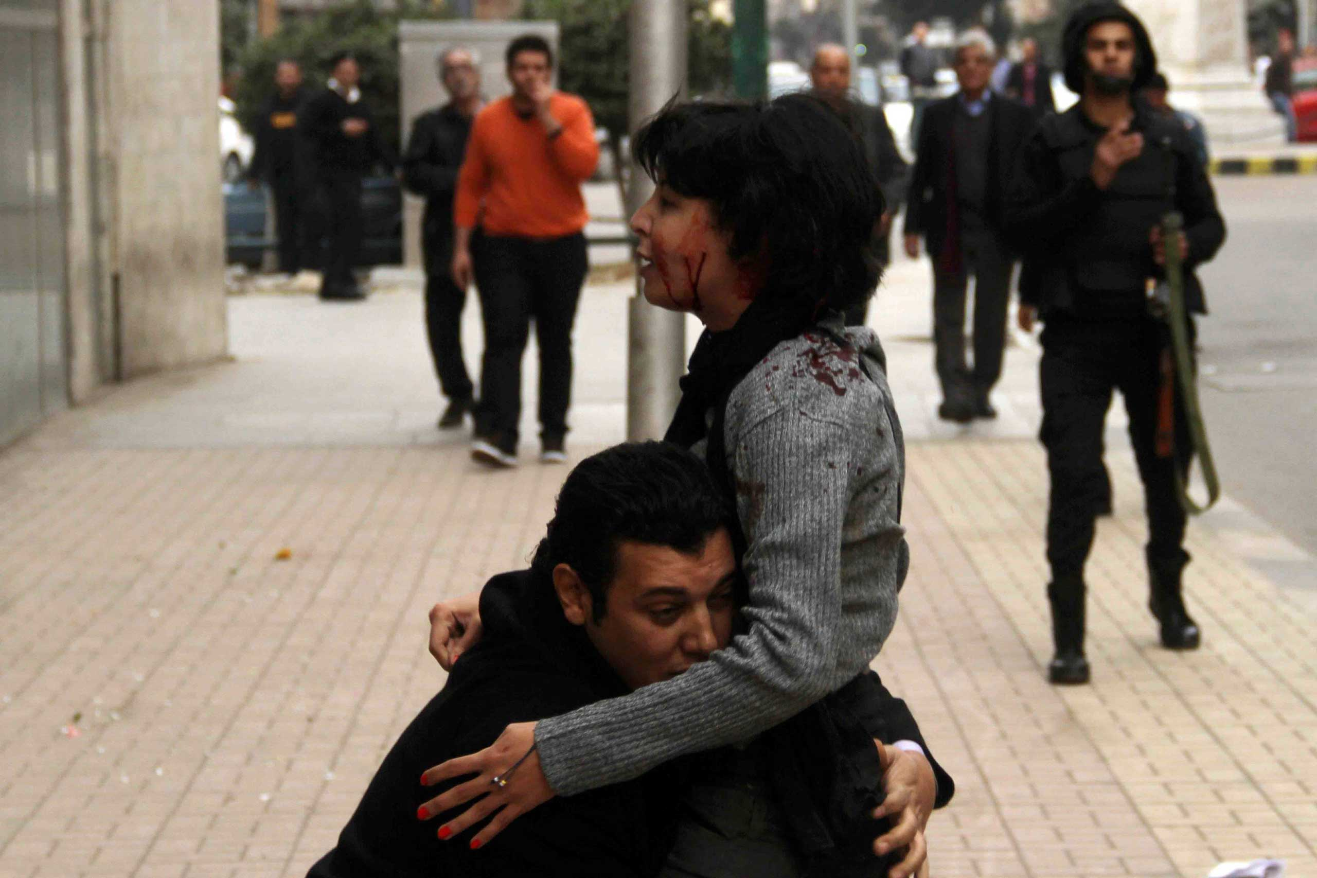 Socialist Popular Alliance Party activist Shaimaa al-Sabbagh receives help after she was shot during a protest by the party in Cairo, Jan. 4, 2015.