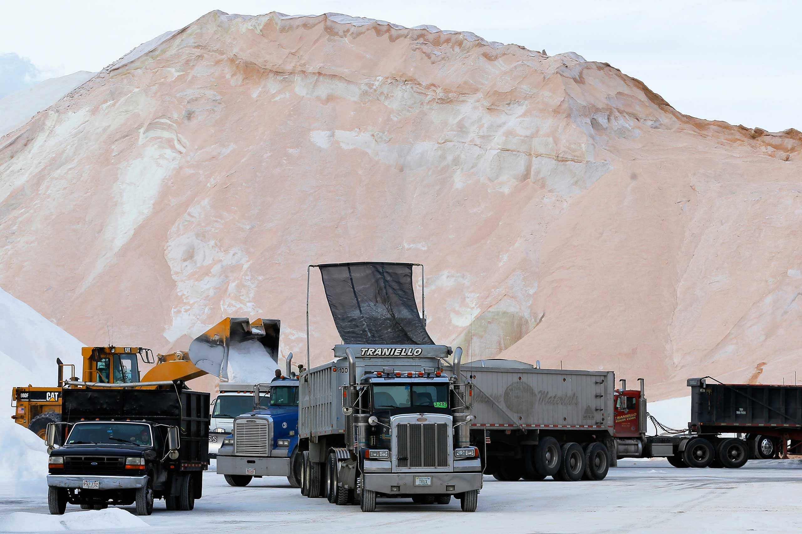 Crews load road salt into trucks ahead of a major winter storm in Chelsea, Mass. on Jan. 26, 2015.