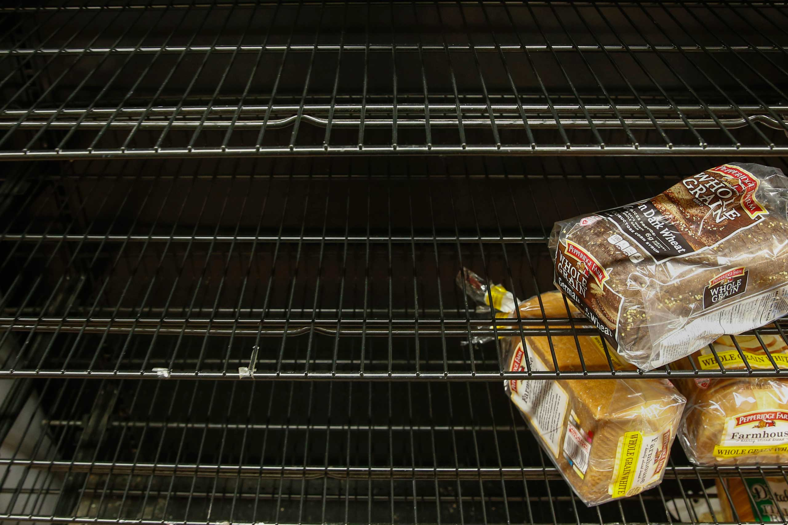 Loaves of bread sit on a sparse shelf at a grocery store in Port Washington, New York on Jan. 26, 2015.