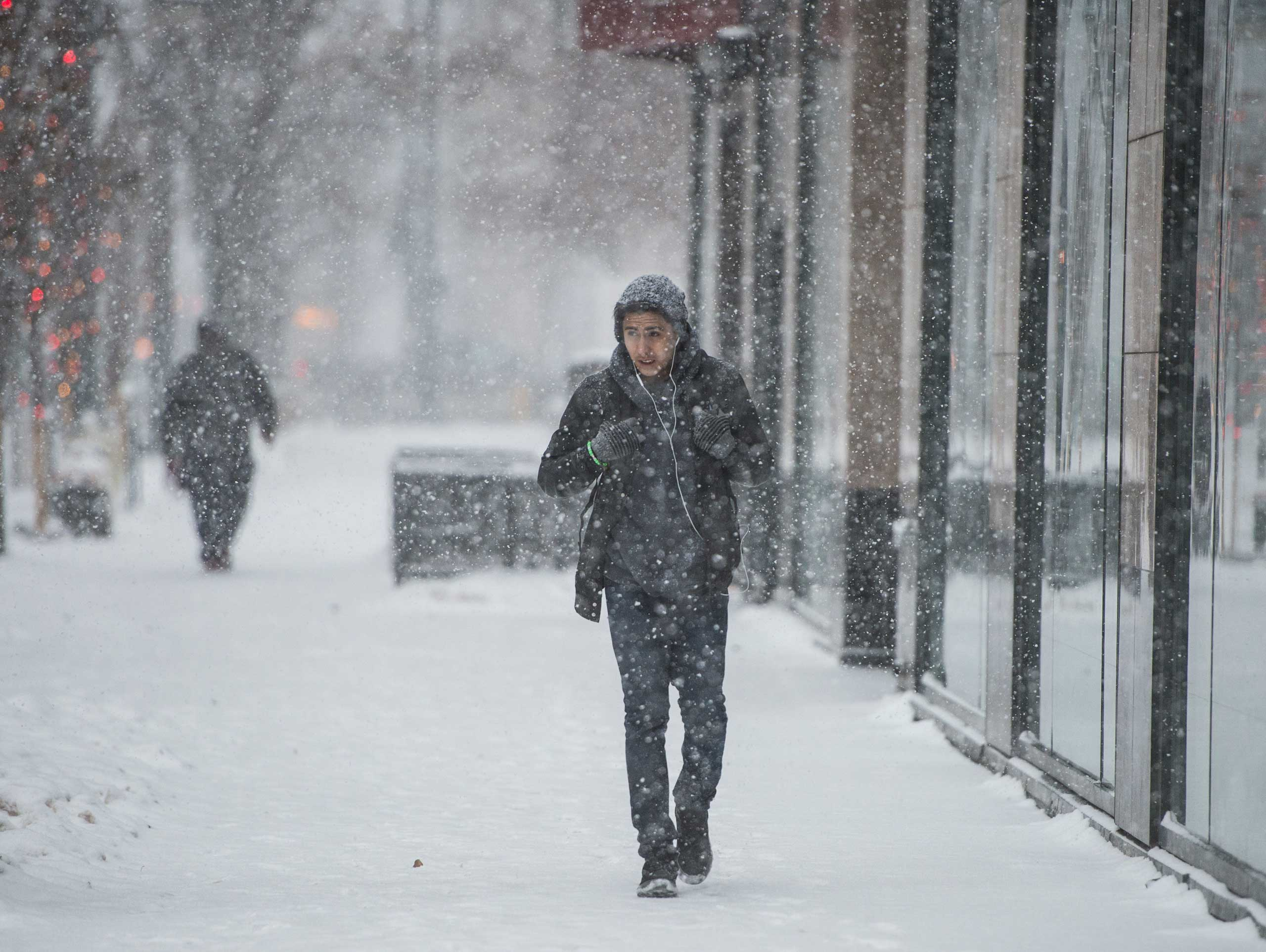 A man walks through heavy snow in Denver on Jan. 3, 2015.