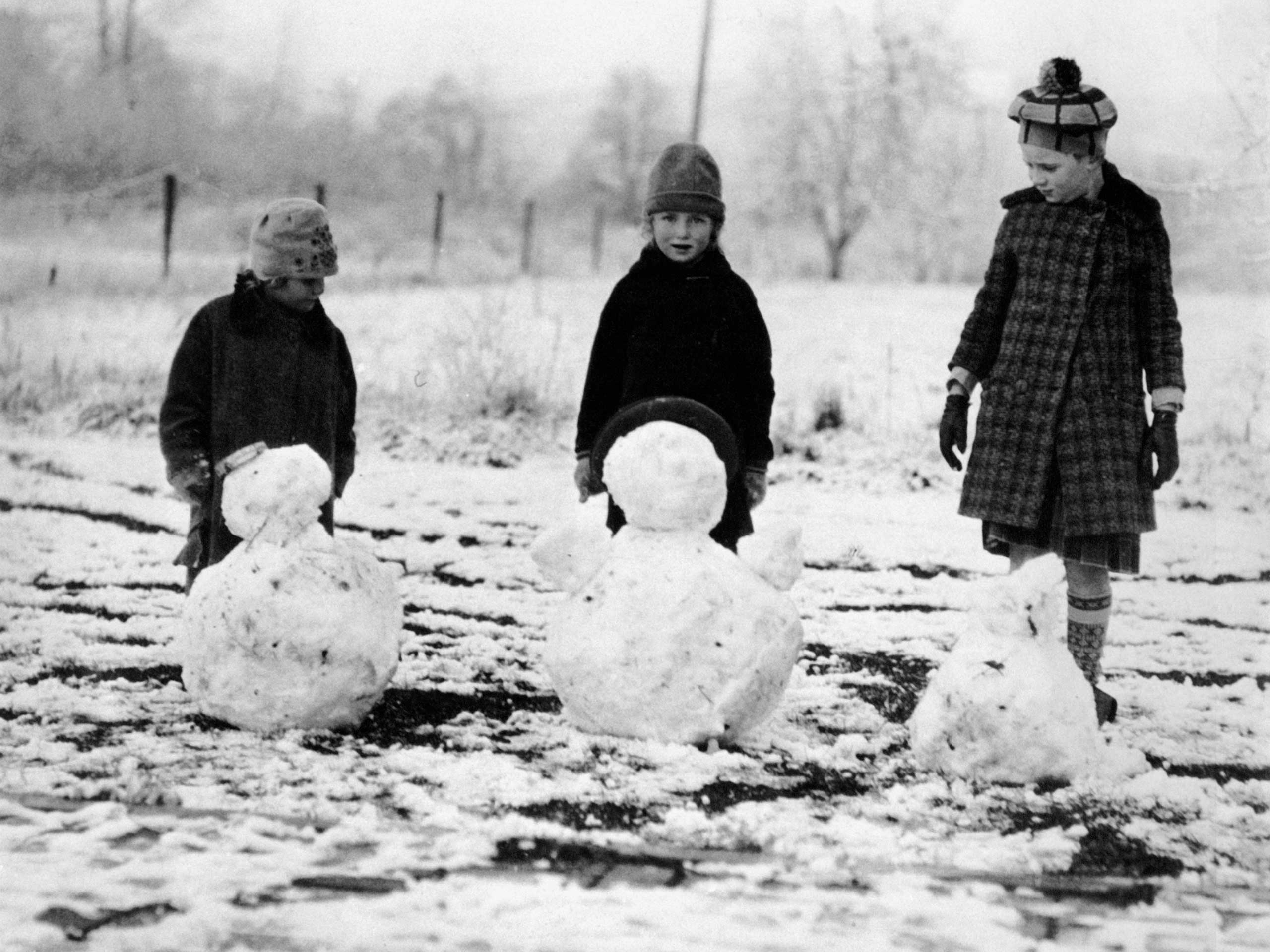 Children making snowmen, late 1920s or early 1930s.