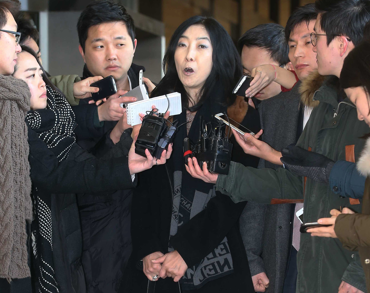 California resident Shin Eun-mi talks to reporters at Seoul District Prosecutors' Office in Seoul on Jan. 7, 2015