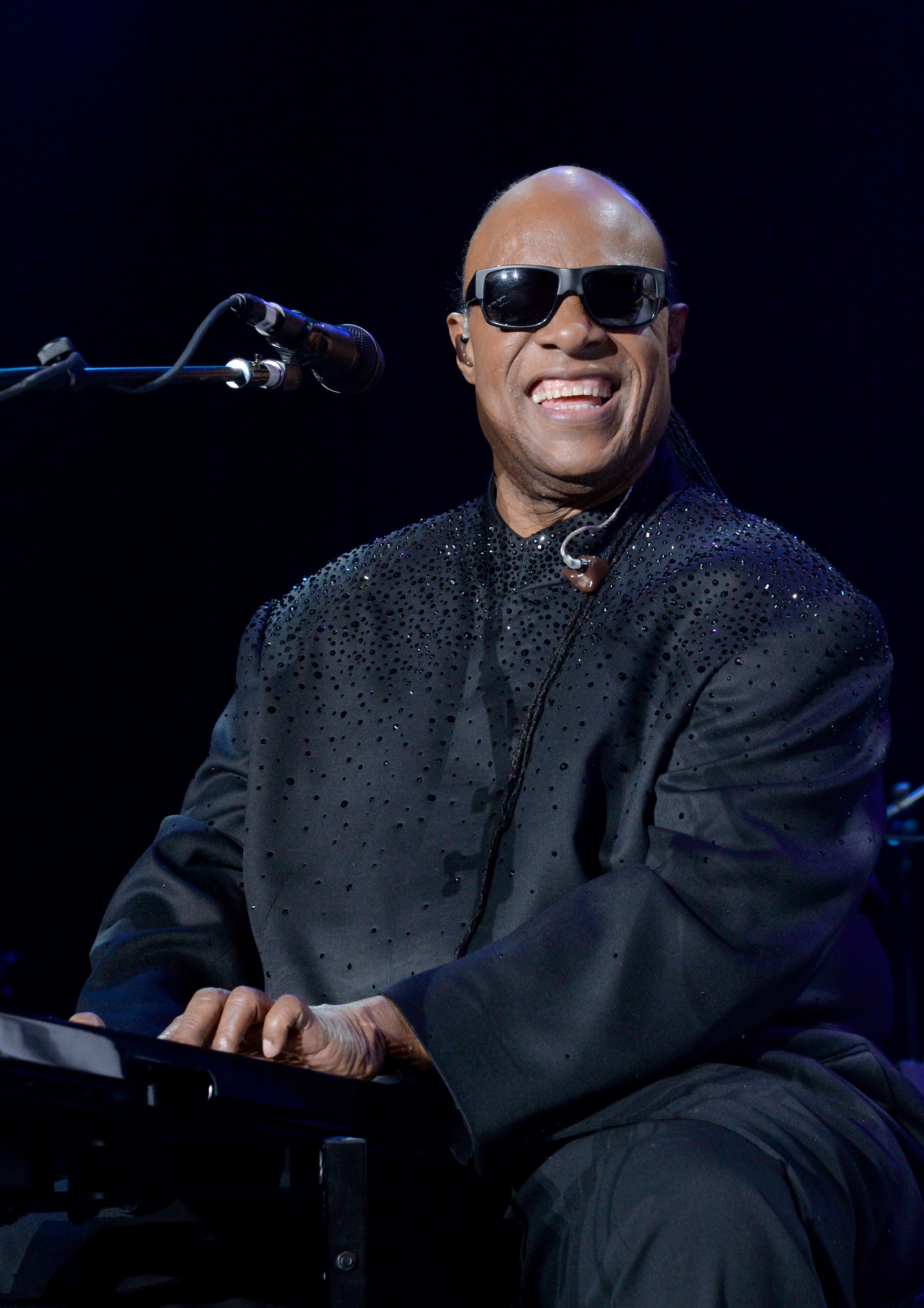 Stevie Wonder performs onstage during the 19th Annual House Full Of Toys Benefit Concert  Songs In the Key Of Life  performance at The Forum on December 20, 2014 in Inglewood, California.