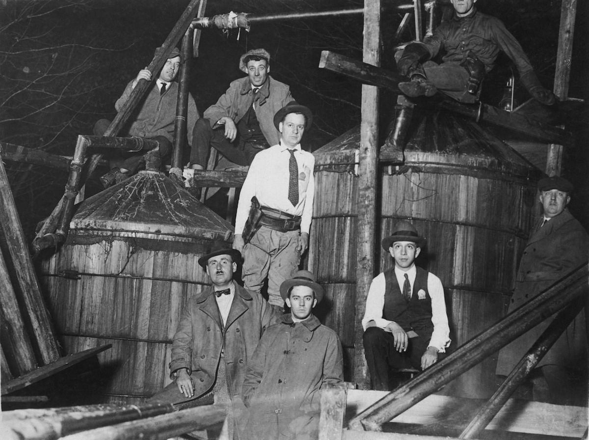 Prohibition agents with a 2000-gallon illicit still, seized near Waldorf, Maryland, circa 1925.