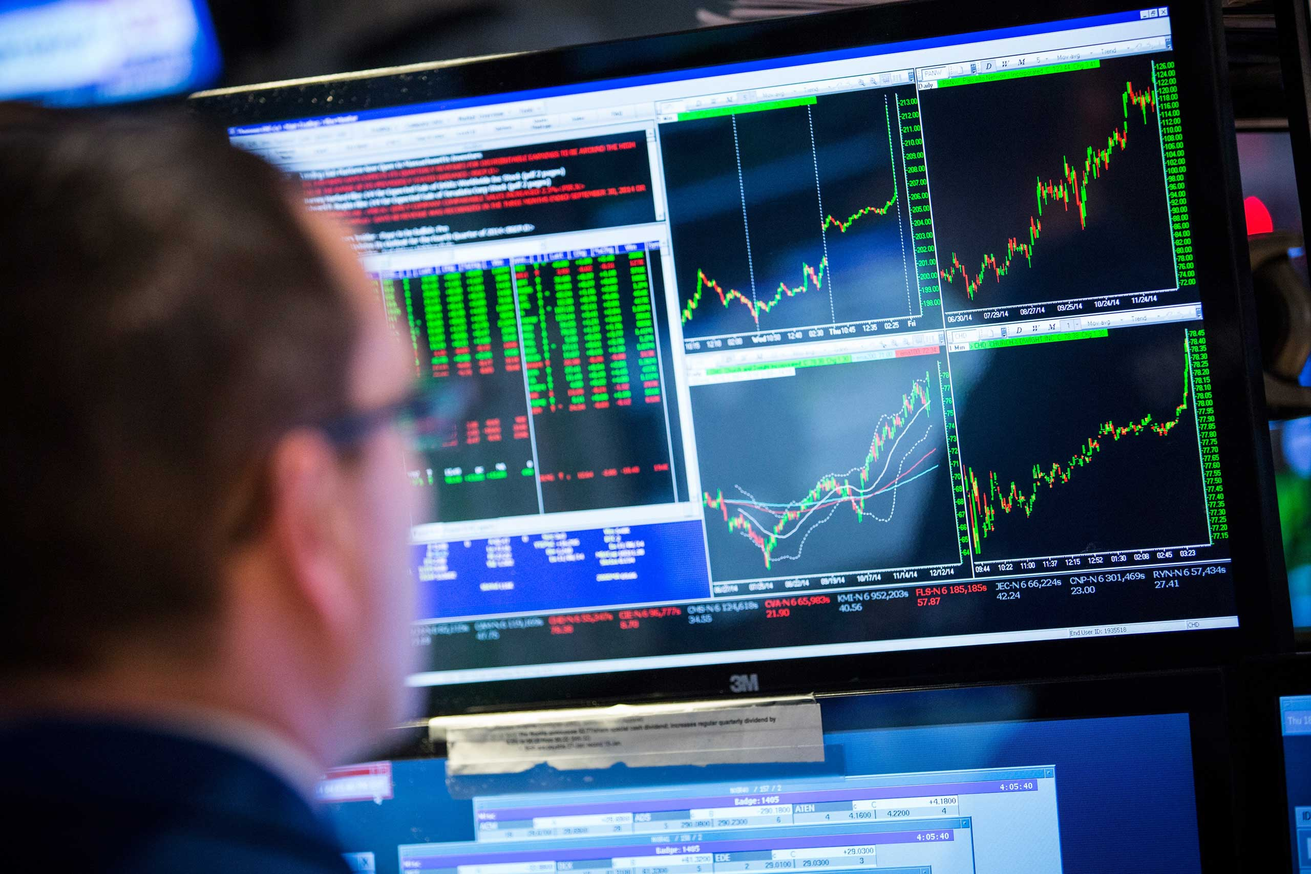 A trader works on the floor of the New York Stock Exchange in New York City during the afternoon of Dec. 18, 2014.