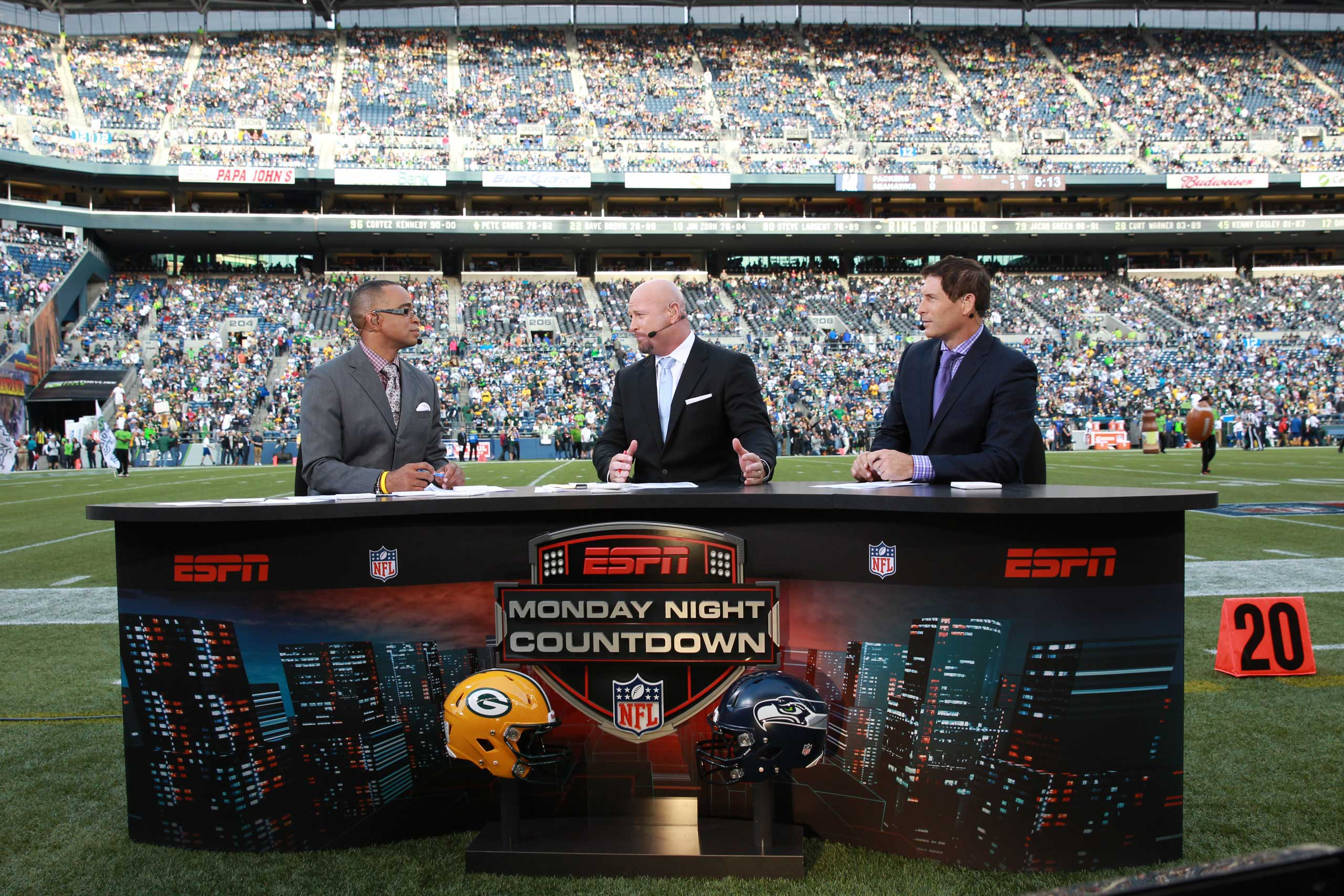 From Left: Stuart Scott, Trent Dilfer and Steve Young sit at their set on the field during an NFL Monday Night Football game between the Seattle Seahawks and the Green Bay Packers in Seattle on Sept. 24, 2012.