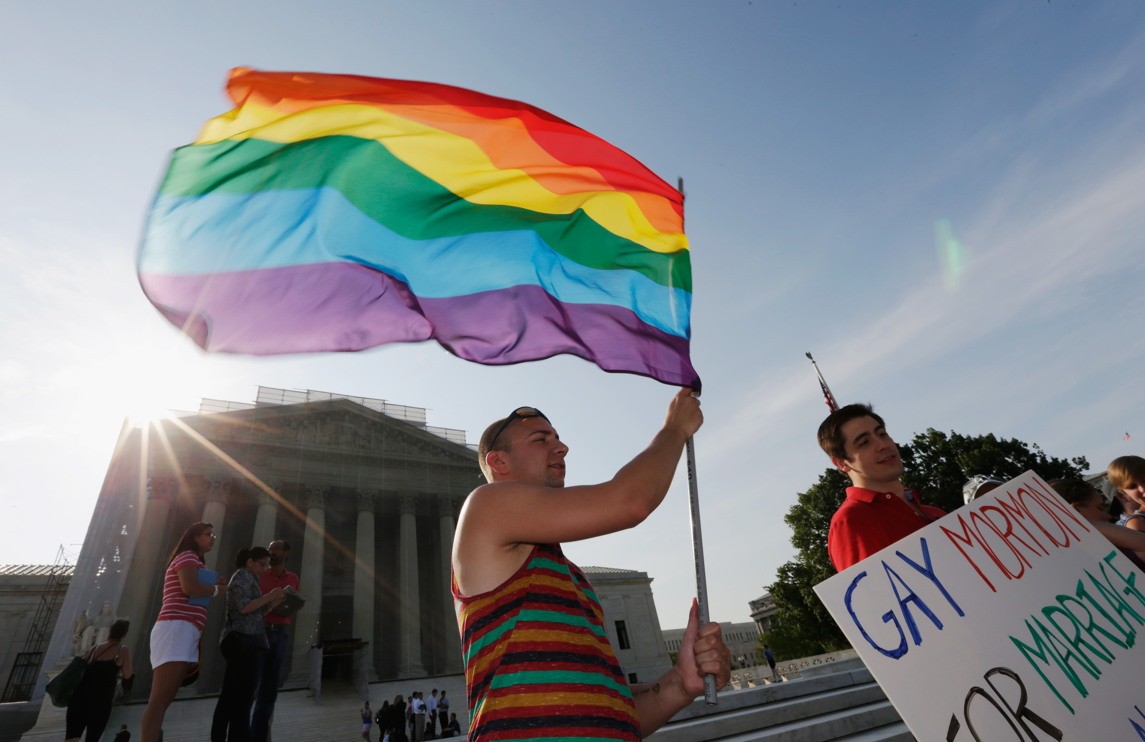Gay rights supporter Vin Testa waves a rainbow flag outside the U.S. Supreme Court building on June 26, 2013 in Washington.