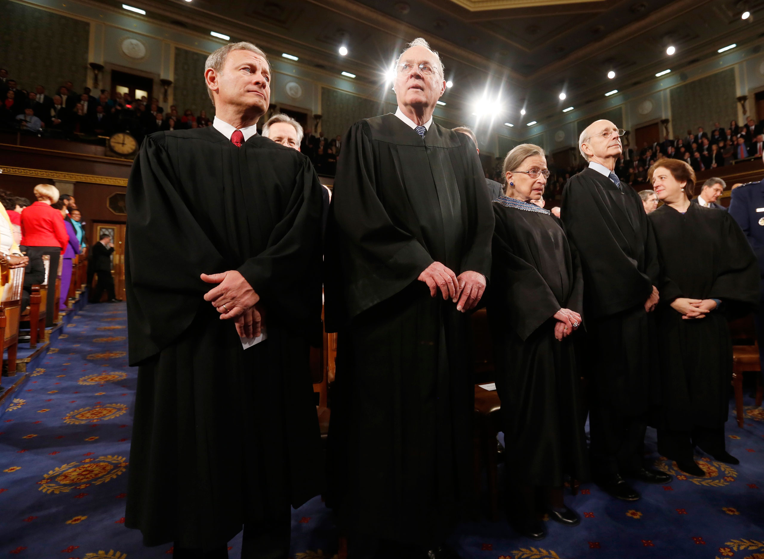 From left: U.S. Supreme Court Chief Justice John Roberts stands with fellow Justices Anthony Kennedy, Ruth Bader Ginsburg, Stephen Breyer and Elena Kagan prior to President Barack Obama's State of the Union speech on Capitol Hill in Washington, D.C. on  Jan. 28, 2014.