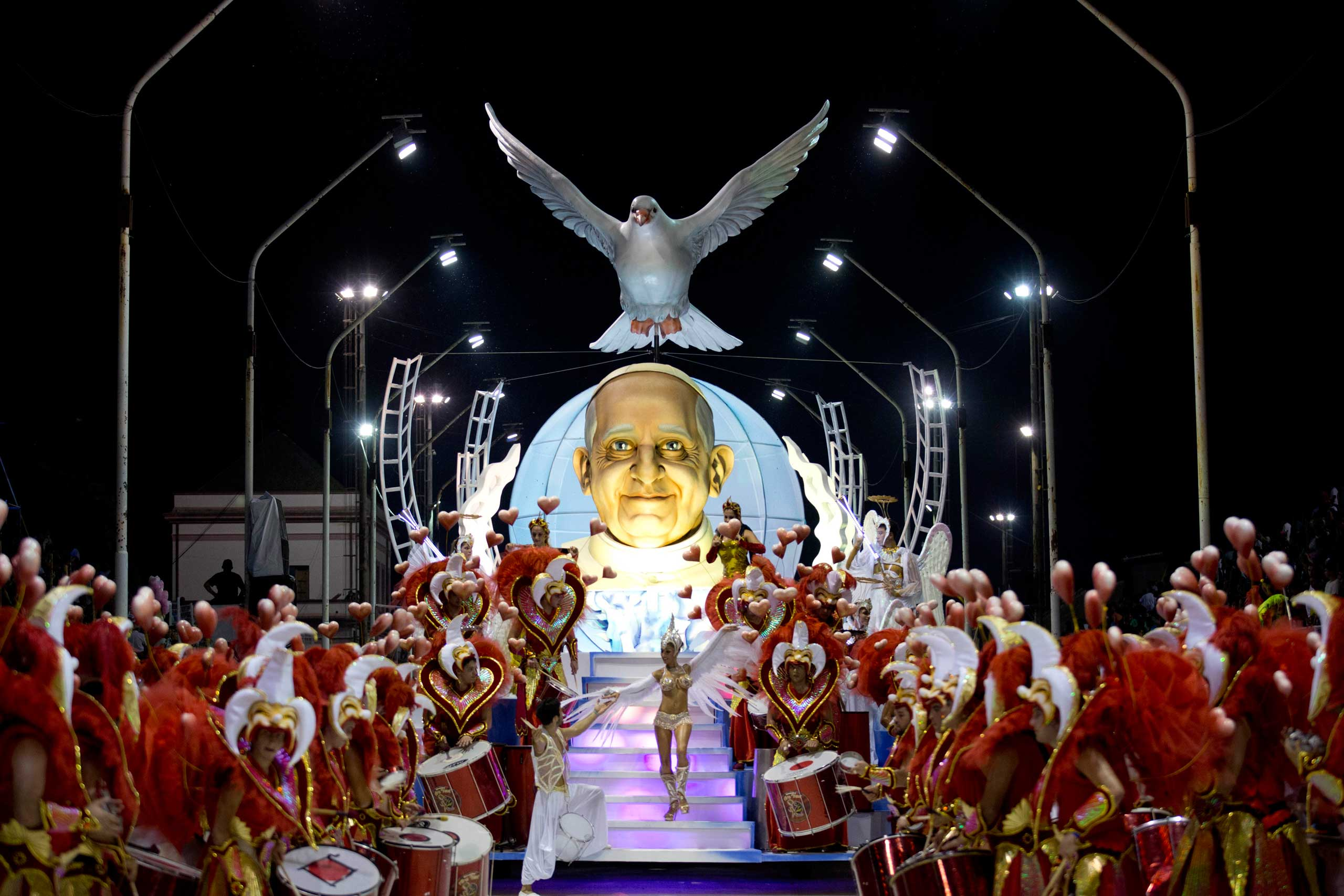 The Ara Yevi samba school performs on a float showcasing Pope Francis during carnival in Gualeguaychu, Argentina, early Sunday, Jan. 11, 2015. Members of the samba school said the Pope doesn't know they chose to honor his life at this year's celebration and look forward for him seeing their performing. (AP Photo/Natacha Pisarenko)