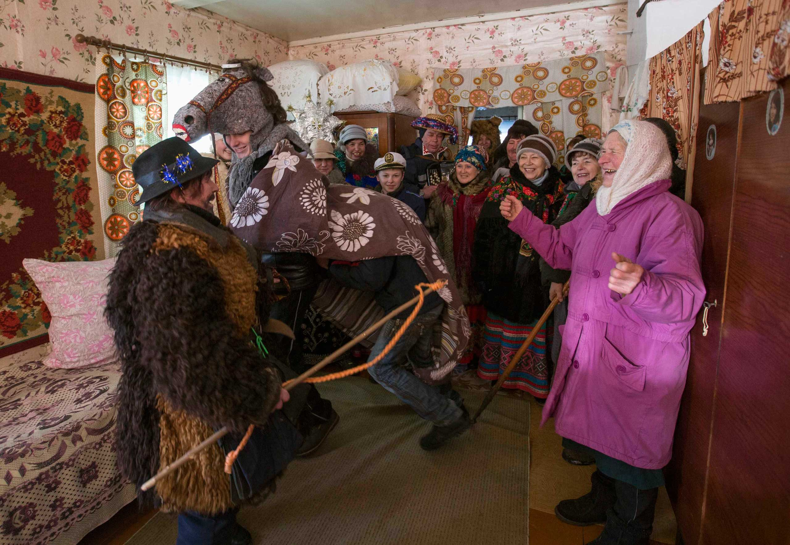People celebrate the pagan rite called  Kolyadki  in the village of Osovo, east of Minsk, Belarus, Jan. 7, 2015.