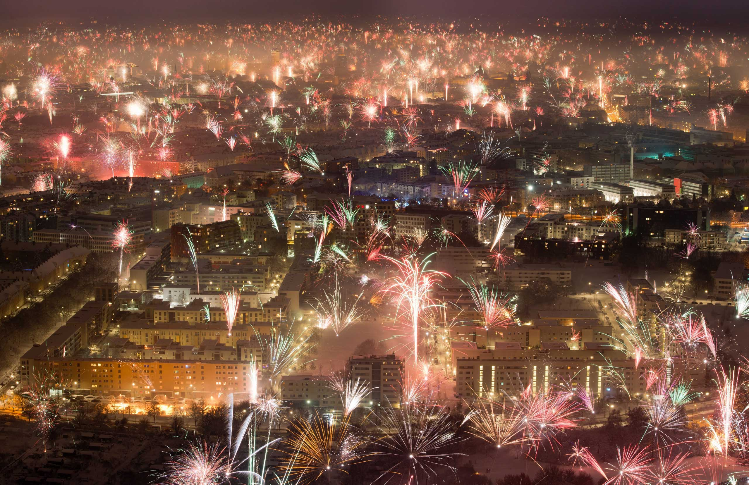 Fireworks illuminate the sky above Munich, southern Germany, early Jan. 1 2015.