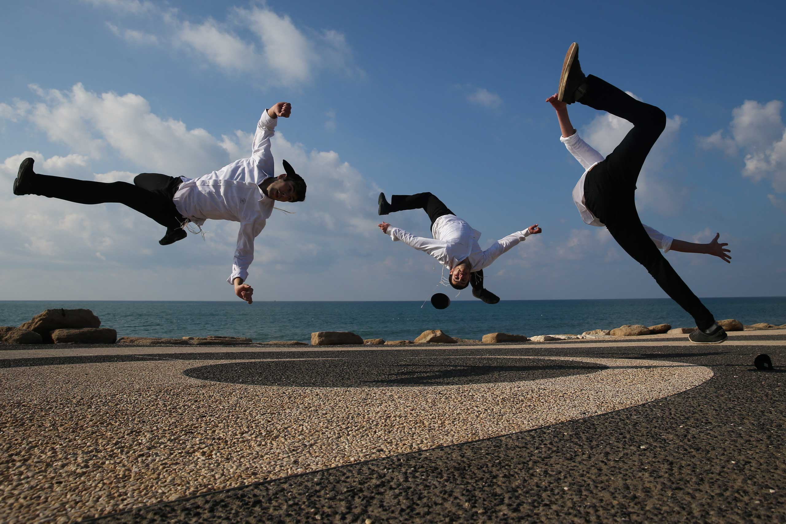 Ultra Orthodox Jews  practice Capoeira, a Brazilian martial art that combines elements of dance, acrobatics and music, near the port of the Israeli Mediterranean city of Tel Aviv-Jaffo on Jan. 18, 2015.