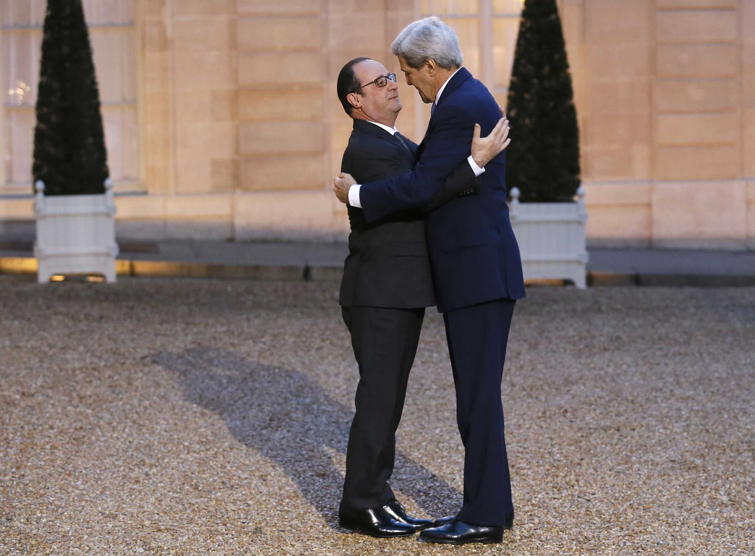 French president Francois Hollande (L) embraces US Secretary of State John Kerry prior to a meeting at the Elysee Palace on Jan. 16, 2015 in Paris.