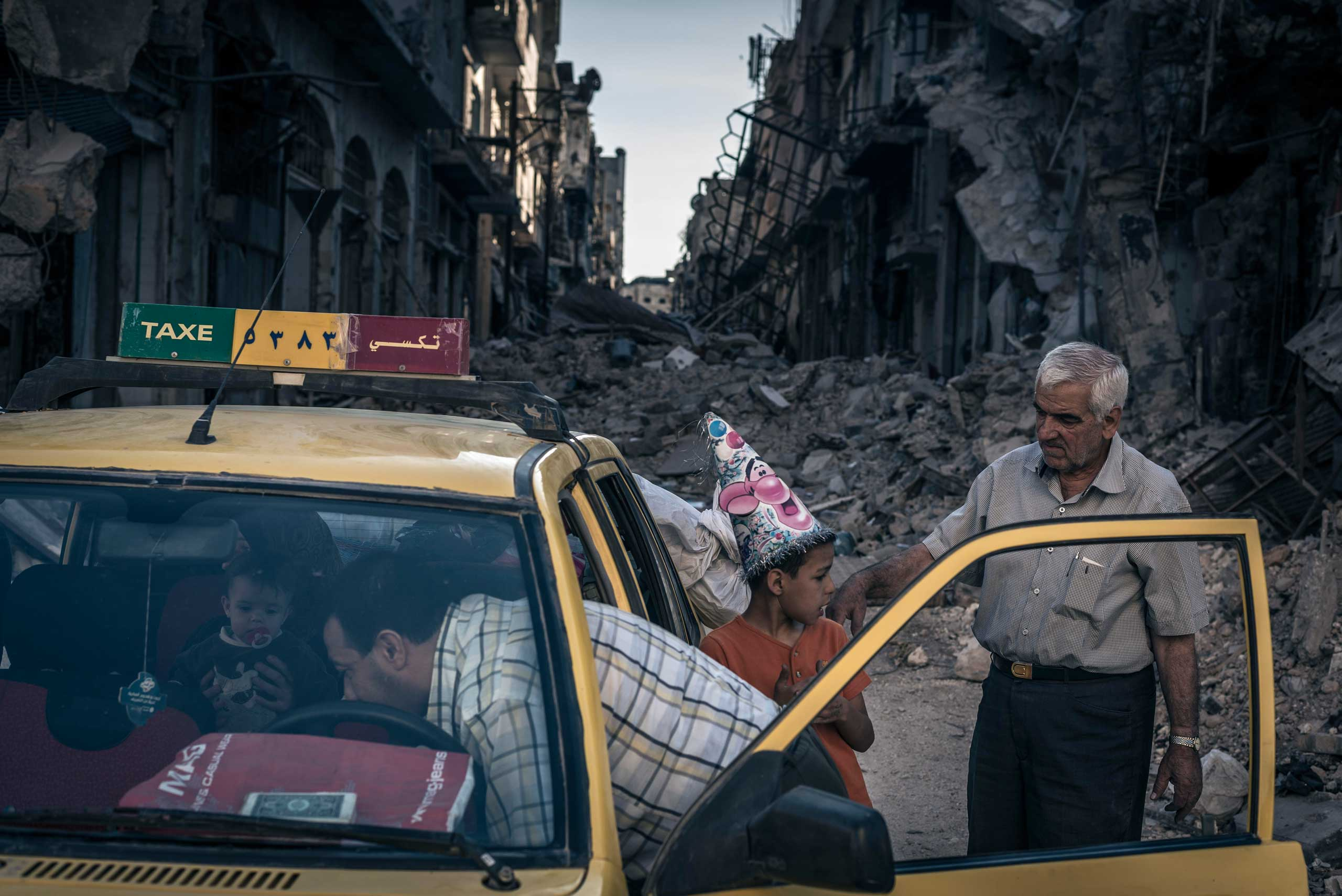 The New York Times: 2014 The Year in PicturesAbu Hisham Abdel Karim loads a taxi with his belongings in the Khalidieh district of Homs, Syria, which had been destroyed by fighting, June 15, 2014.