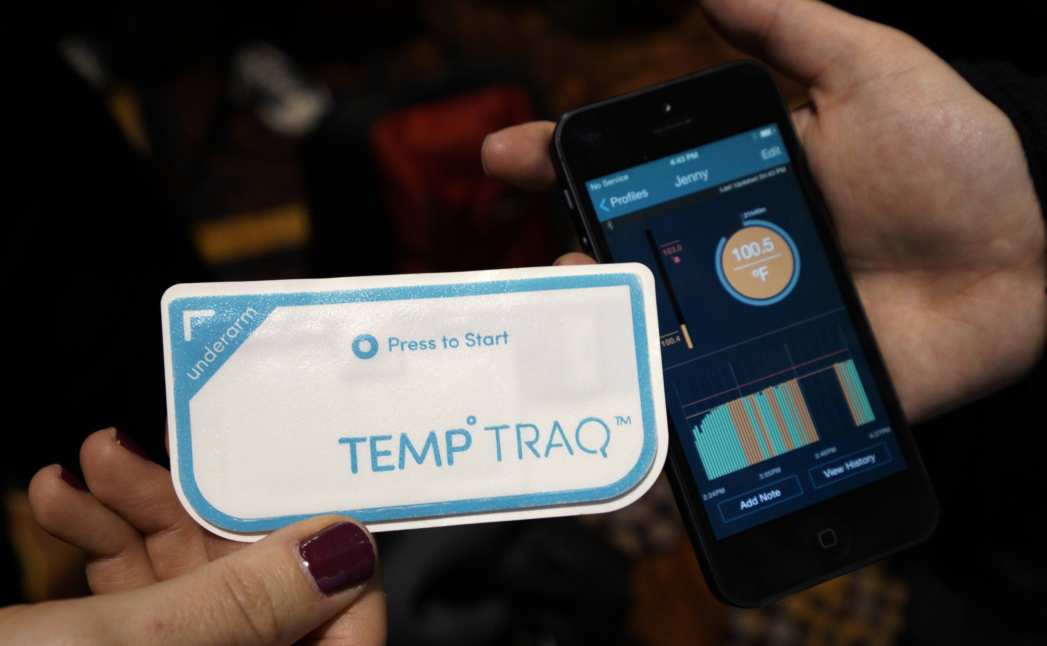 TempTraq body temperature wearable bluetooth thermometer and its accompanying app are displayed at the International Consumer Electronics show in Las Vegas