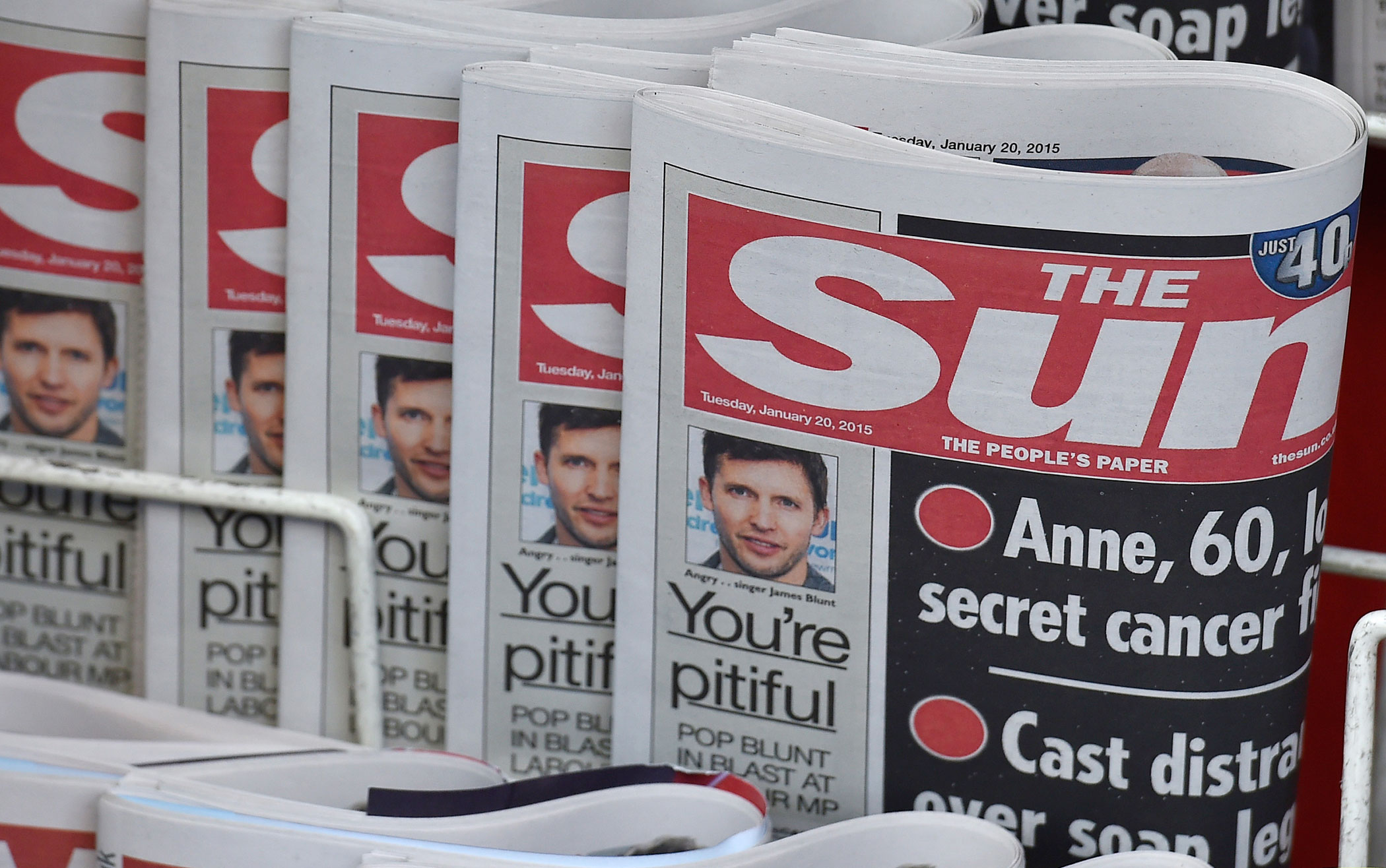 Copies of The Sun newspaper are seen on a newsstand outside a shop in central London Jan. 20, 2015.