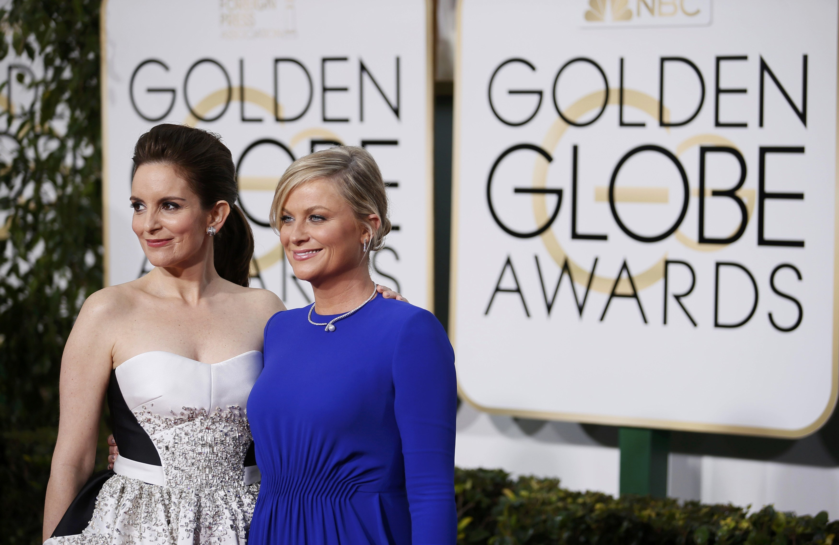 Show hosts Tina Fey and Amy Poehler arrive at the 72nd Golden Globe Awards in Beverly Hills on Jan. 11, 2015.