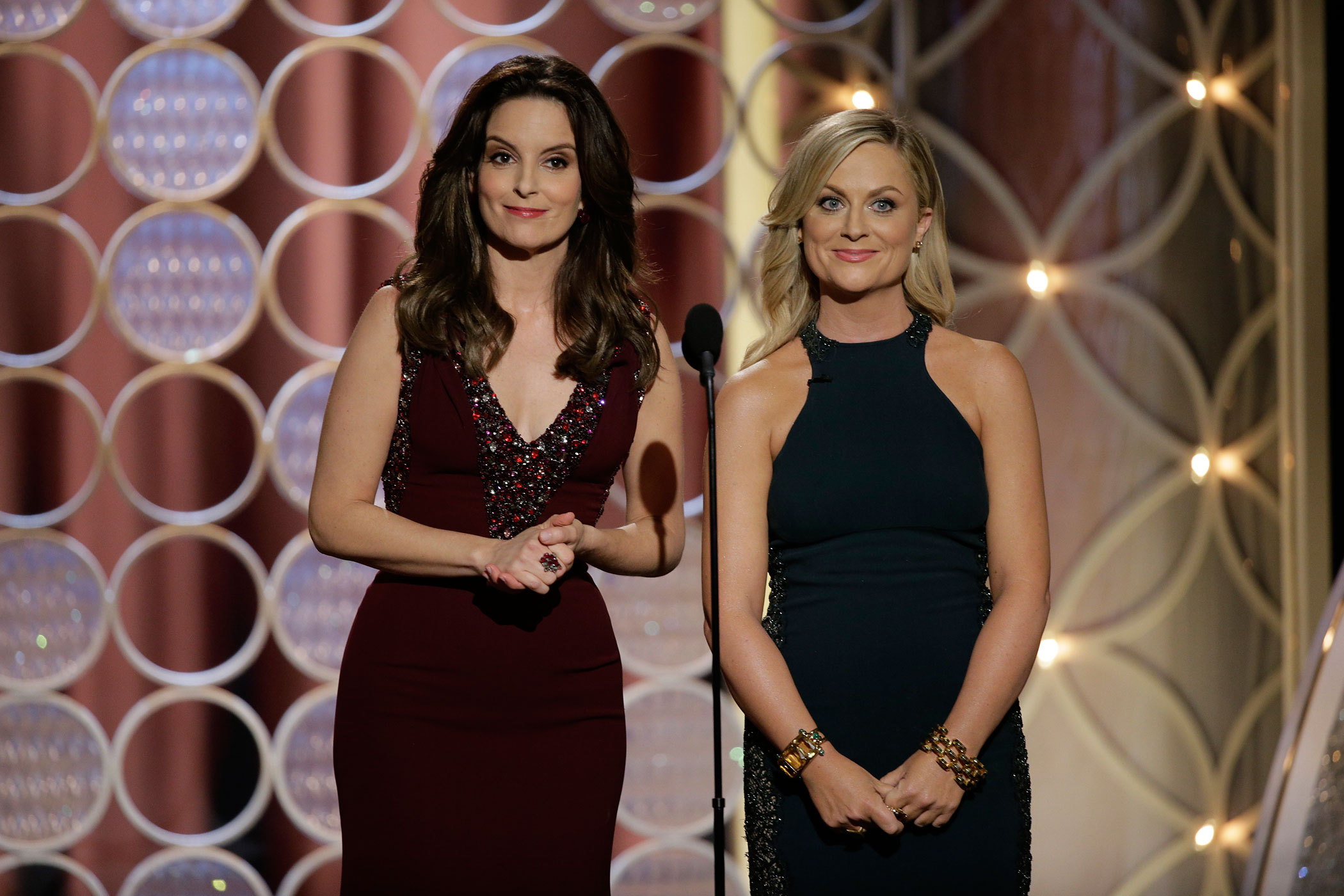 Hosts Tina Fey and Amy Poehler speak onstage during the 71st Annual Golden Globe Award at The Beverly Hilton Hotel on Jan. 12, 2014 in Beverly Hills, Calif.