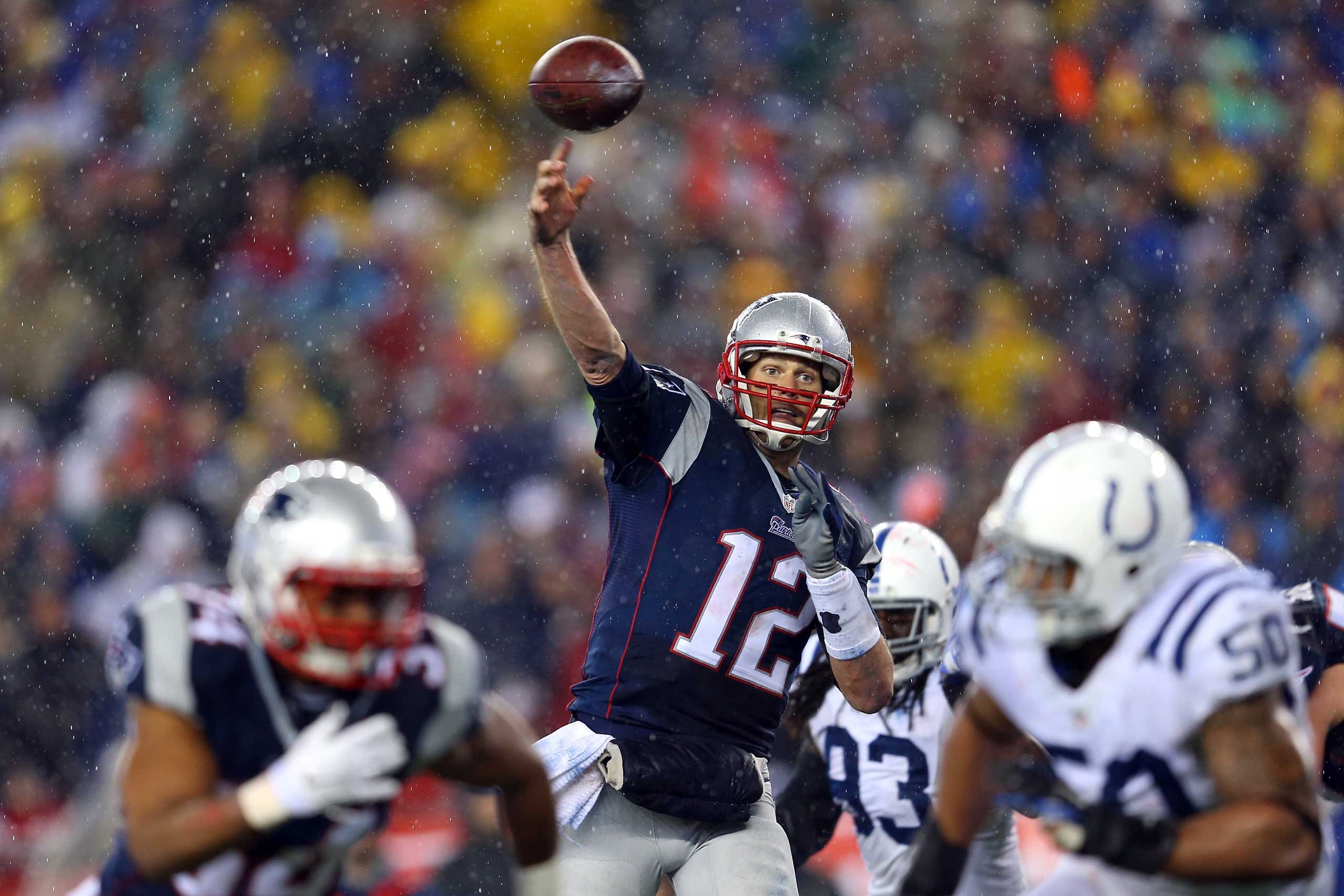 Tom Brady of the New England Patriots throws a touchdown pass against the Indianapolis Colts during the 2015 AFC Championship Game on Jan. 18, 2015 in Foxboro, Mass.