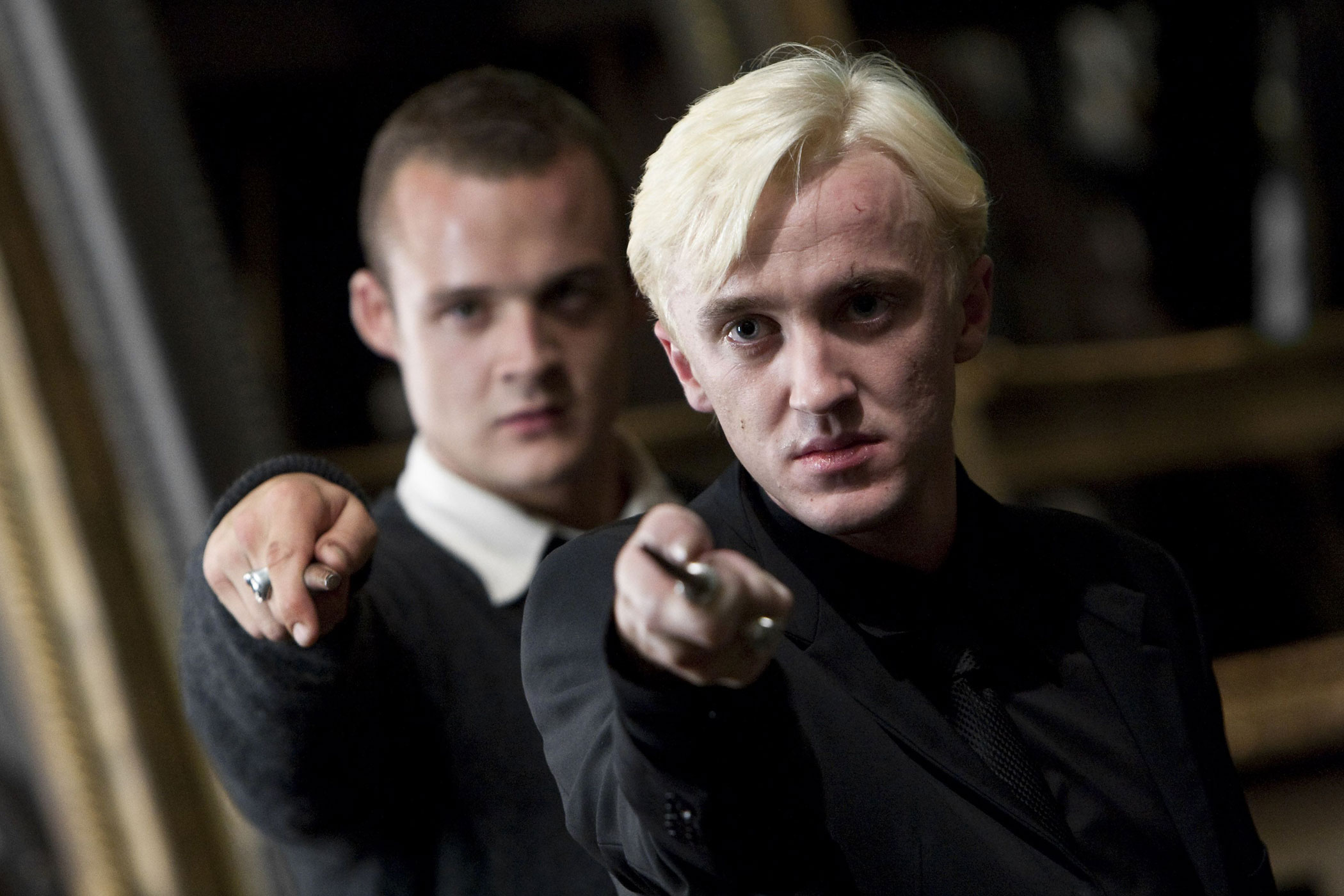 Tom Felton, right, as Draco Malfoy in Harry Potter and the Deathly Hallows — Part 2