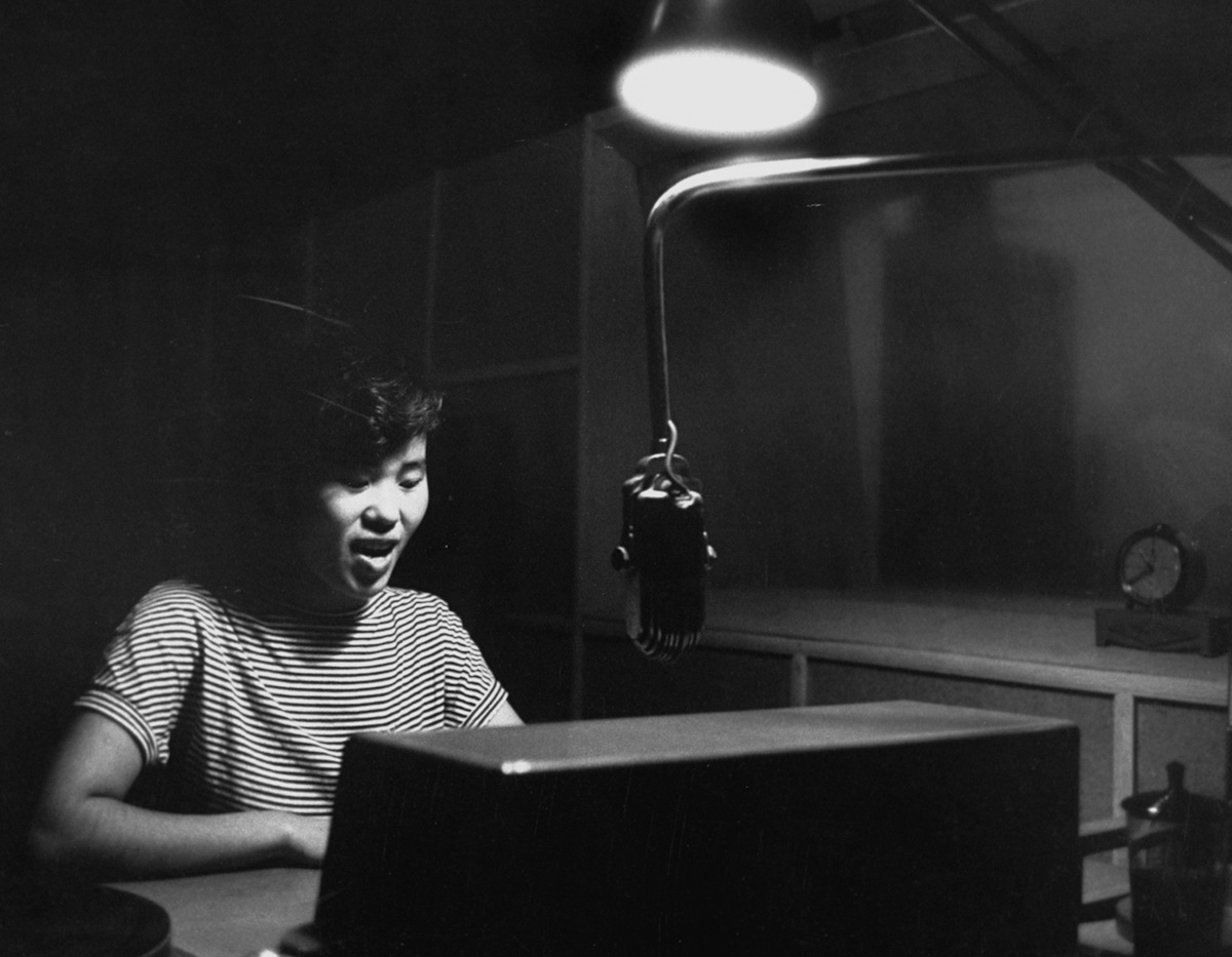 Tokyo Rose, a Nationalist Chinese radio broadcaster, at work