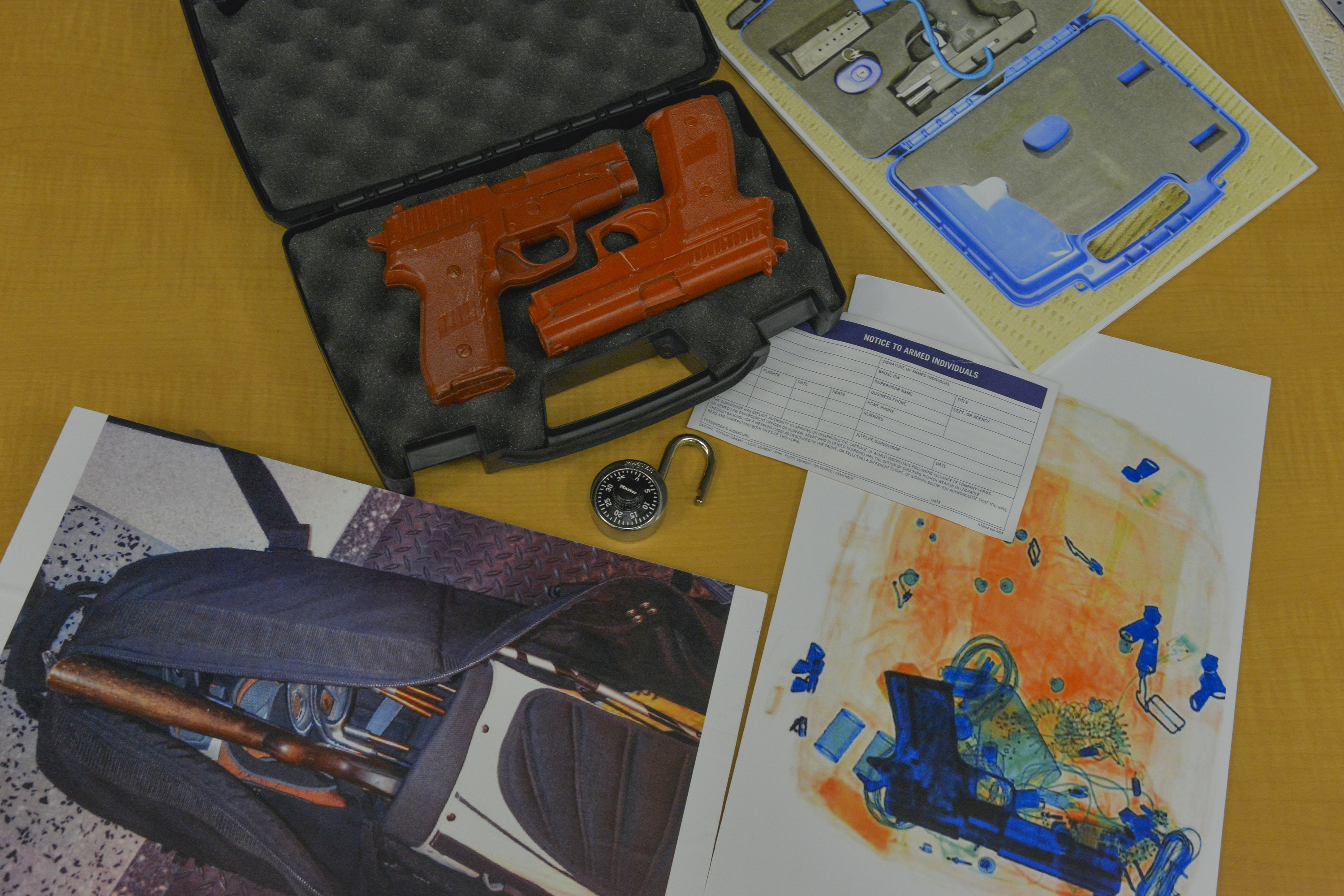 After filling out a brief disclosure form, commercial air flight travelers are allowed to transport unloaded firearms in locked, hard-sided cases as checked luggage only, as can be seen in props provided by the Transportation Security Administration (TSA) at Dulles International Airport on Wednesday, June 11, 2014, in Washington, DC.