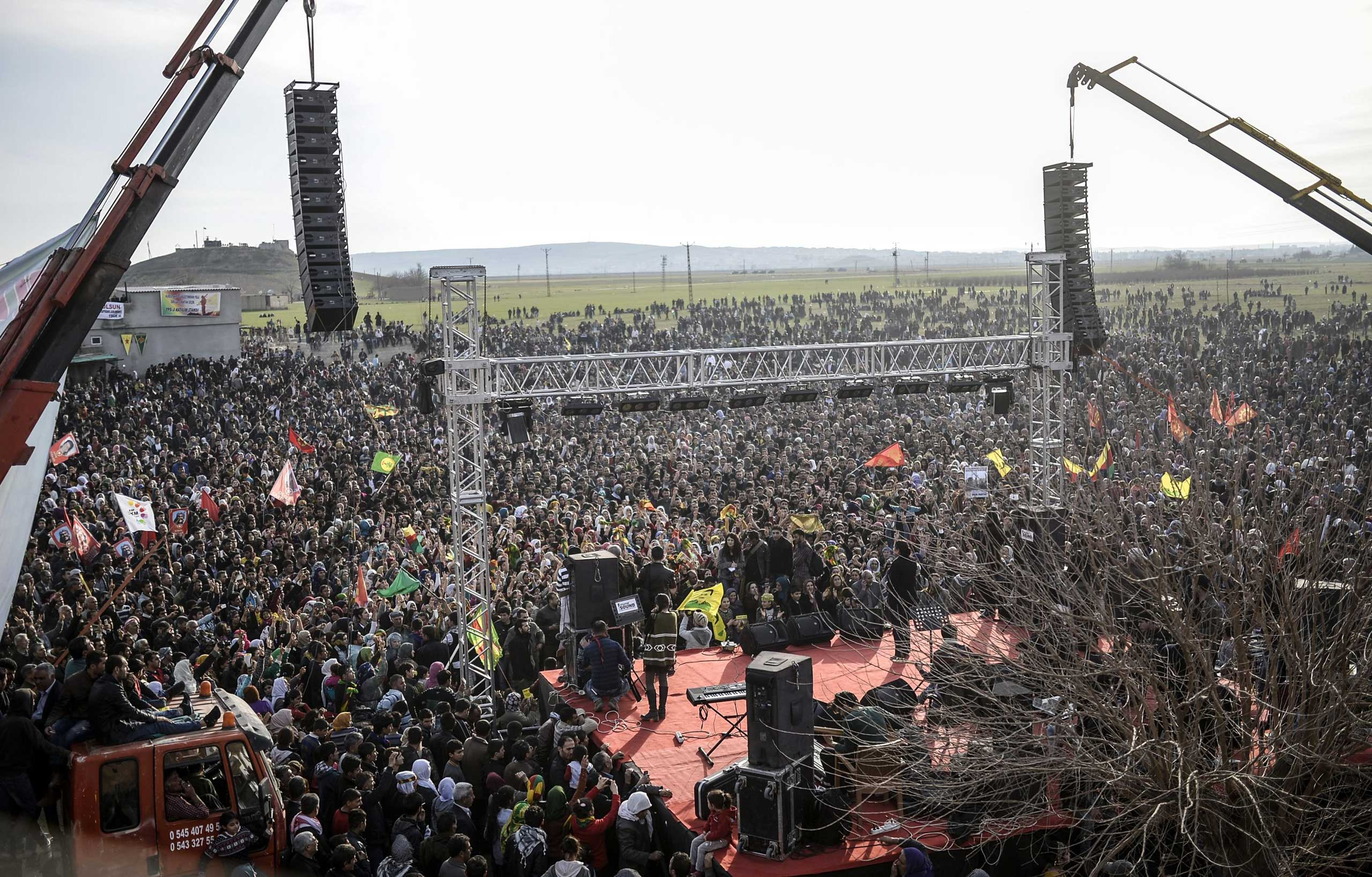 Kurdish people celebrate the declared victory over ISIS for control of Kobani near the Turkish-Syrian border in Suruc, Turkey, Jan. 27, 2015.