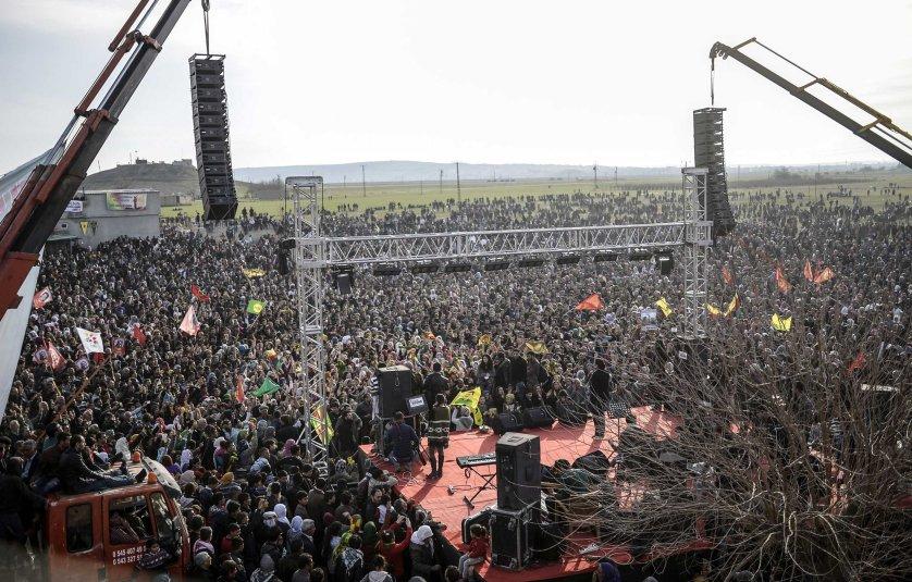Kurdish people celebrate near the Turkish-Syrian border in Suruc, Jan. 27, 2015.