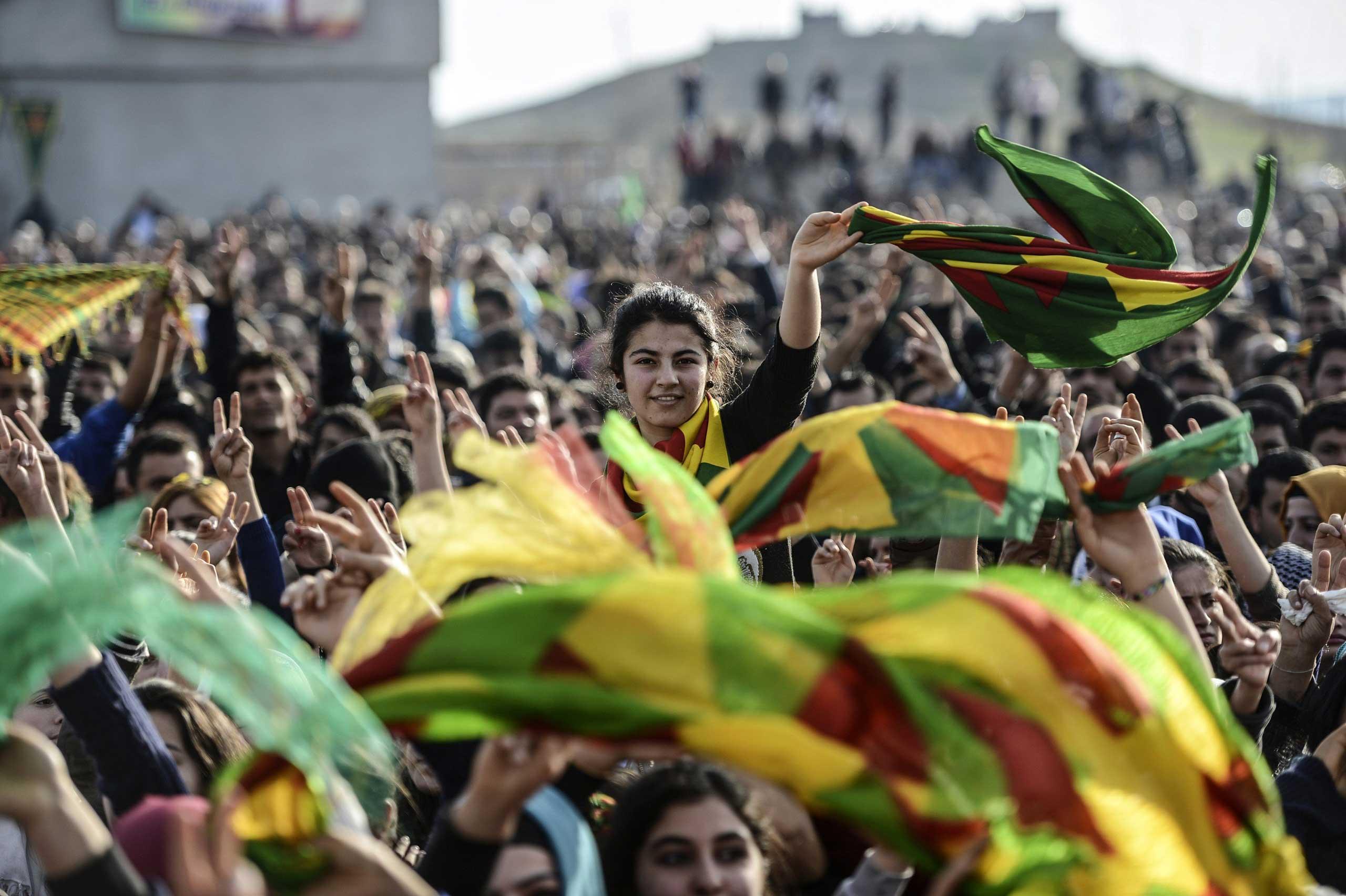 Kurdish people attend a celebration rally near the Turkish-Syrian border in Suruc, Turkey, on Jan. 27, 2015.