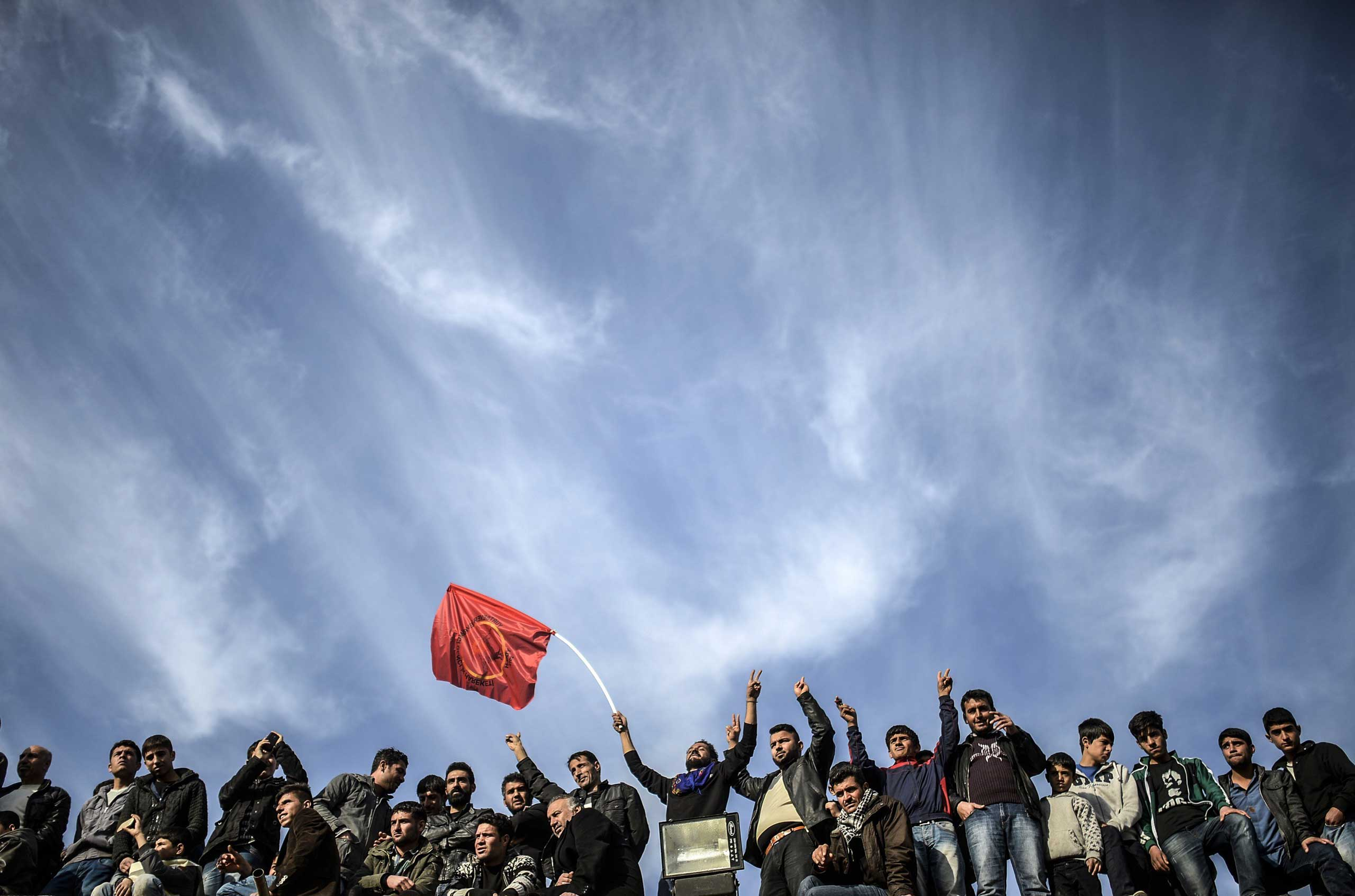 Kurdish people celebrate the declared victory over ISIS for control of Kobani near the Turkish-Syrian border in Suruc, Turkey, on Jan. 27, 2015.