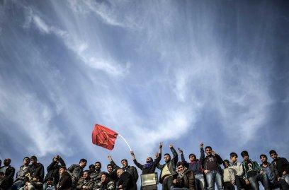Kurdish people celebrate near the Turkish-Syrian border in Suruc, in Sanliurfa province in Turkey on Jan. 27, 2015.