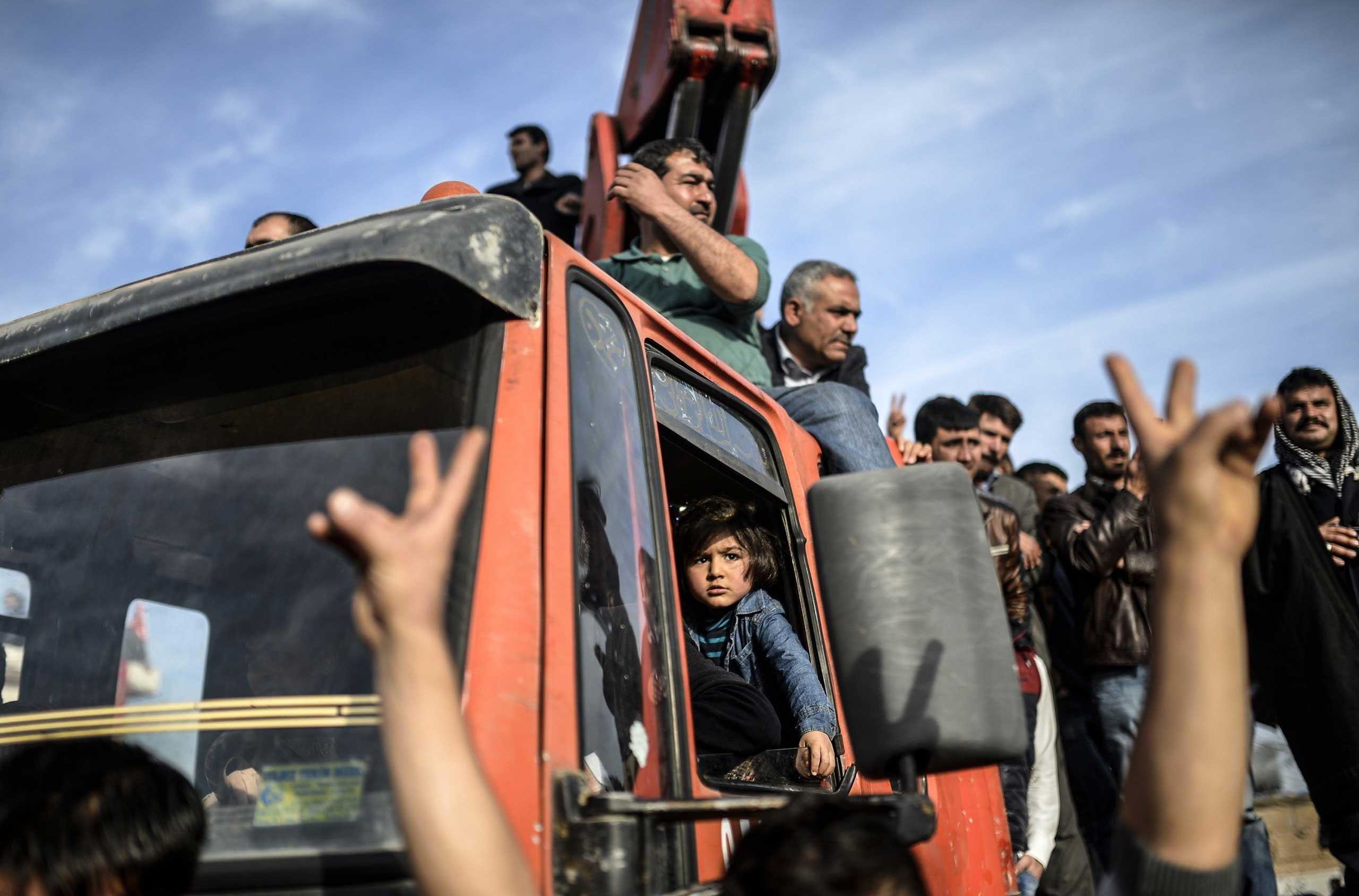 Kurdish attend a celebration rally near the Turkish-Syrian border in Suruc, Turkey, on Jan. 27, 2015.
