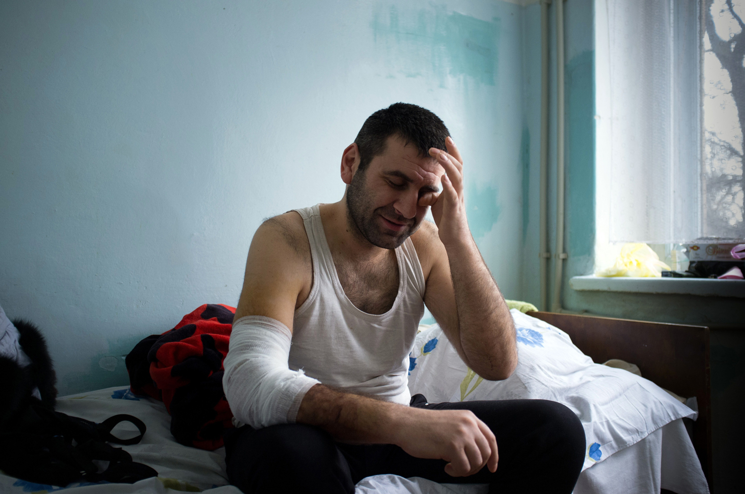 Azif Alikberov recovers in a hospital after being wounded as fighting erupted in Mariupol, Ukraine on Jan. 26, 2014.