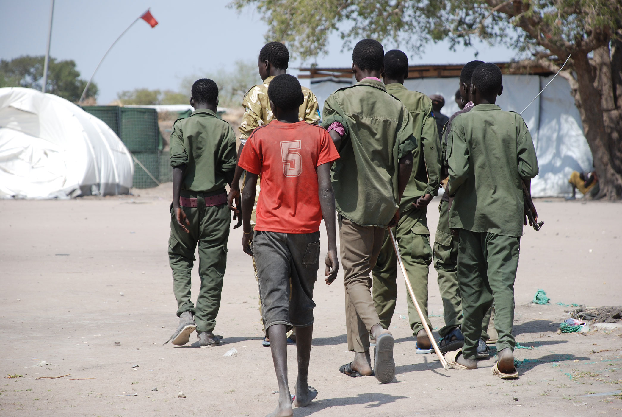 Child soldiers at Cobra camp in Gumuruk, South Sudan go to a demobilization ceremony.