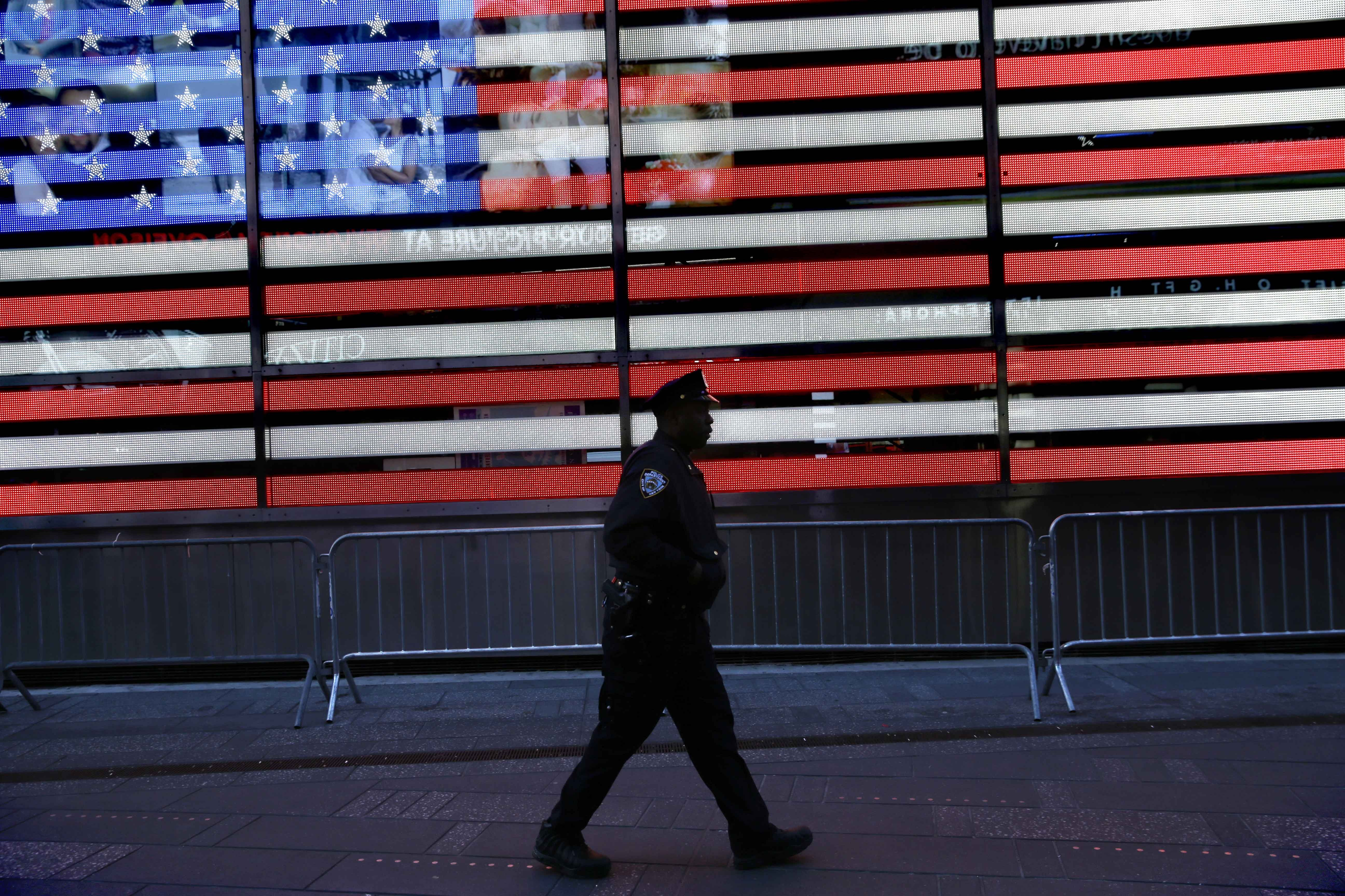 A police officer walks through Times Square in New York on Jan. 8, 2015.