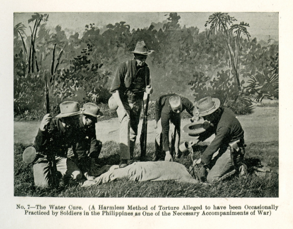 A group of American soldiers applying the 'water cure' upon a Filipino insurgent during the Philippine-American War, circa 1900. From a book published in 1902.