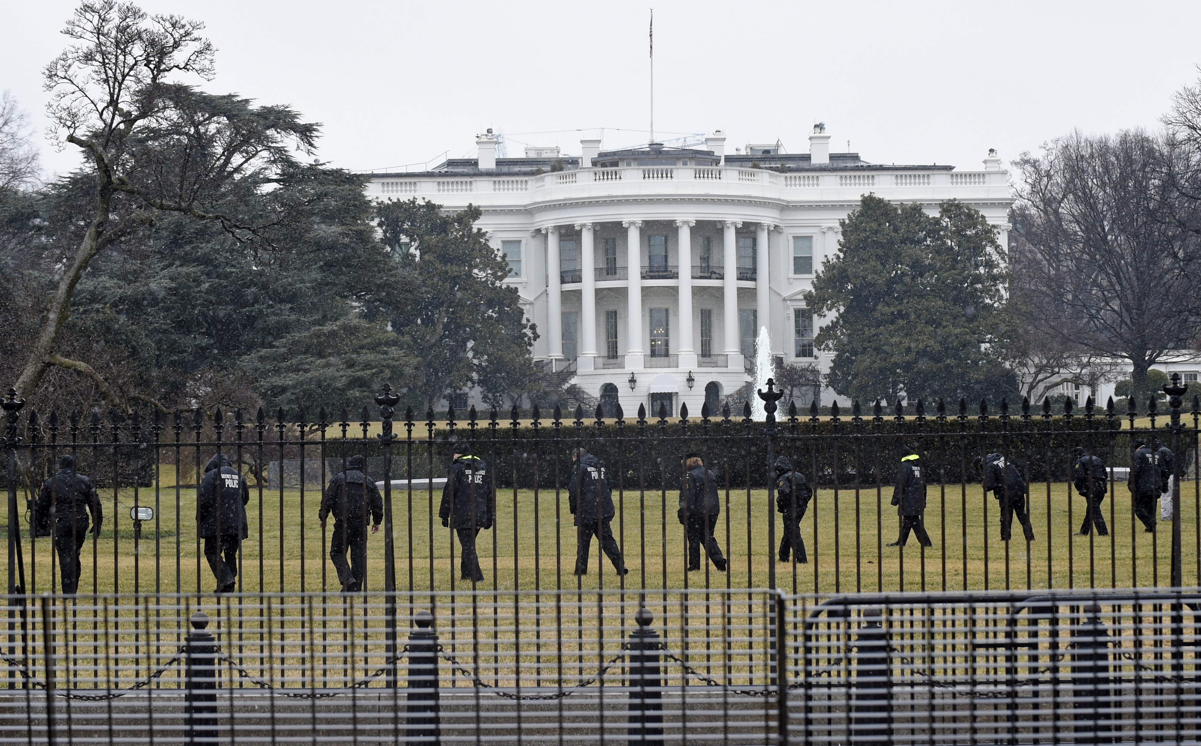 Secret Service officers search the south grounds of the White House for an unmanned aerial drone in Washington D.C. on  Jan. 26, 2015.