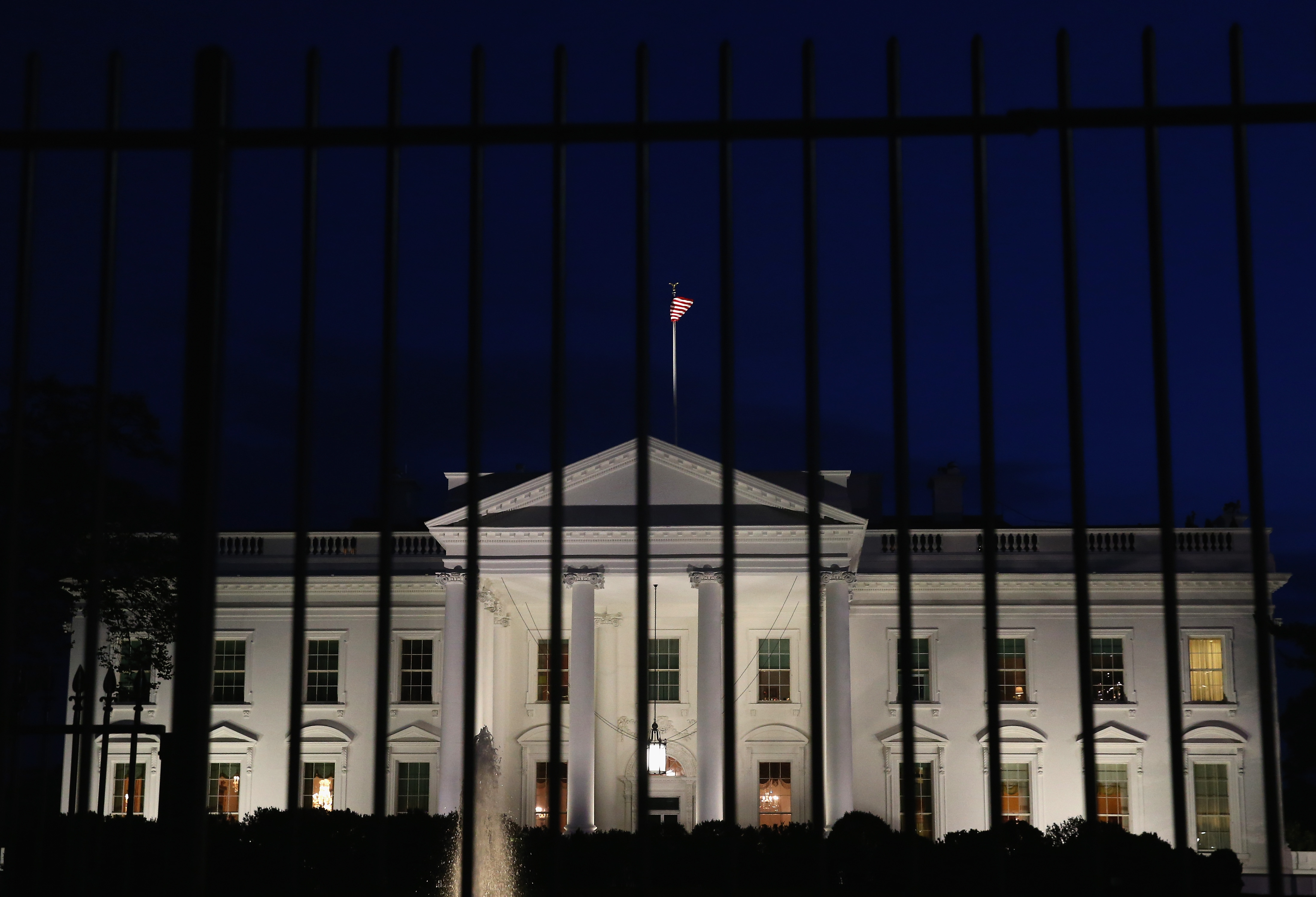 A tall security fence stands in front of the White House on Nov. 4, 2014, in Washington, D.C.