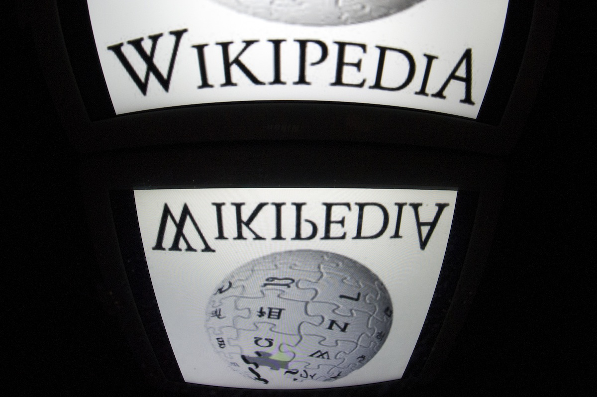 The  Wikipedia  logo is seen on a tablet screen on Dec. 4, 2012 in Paris