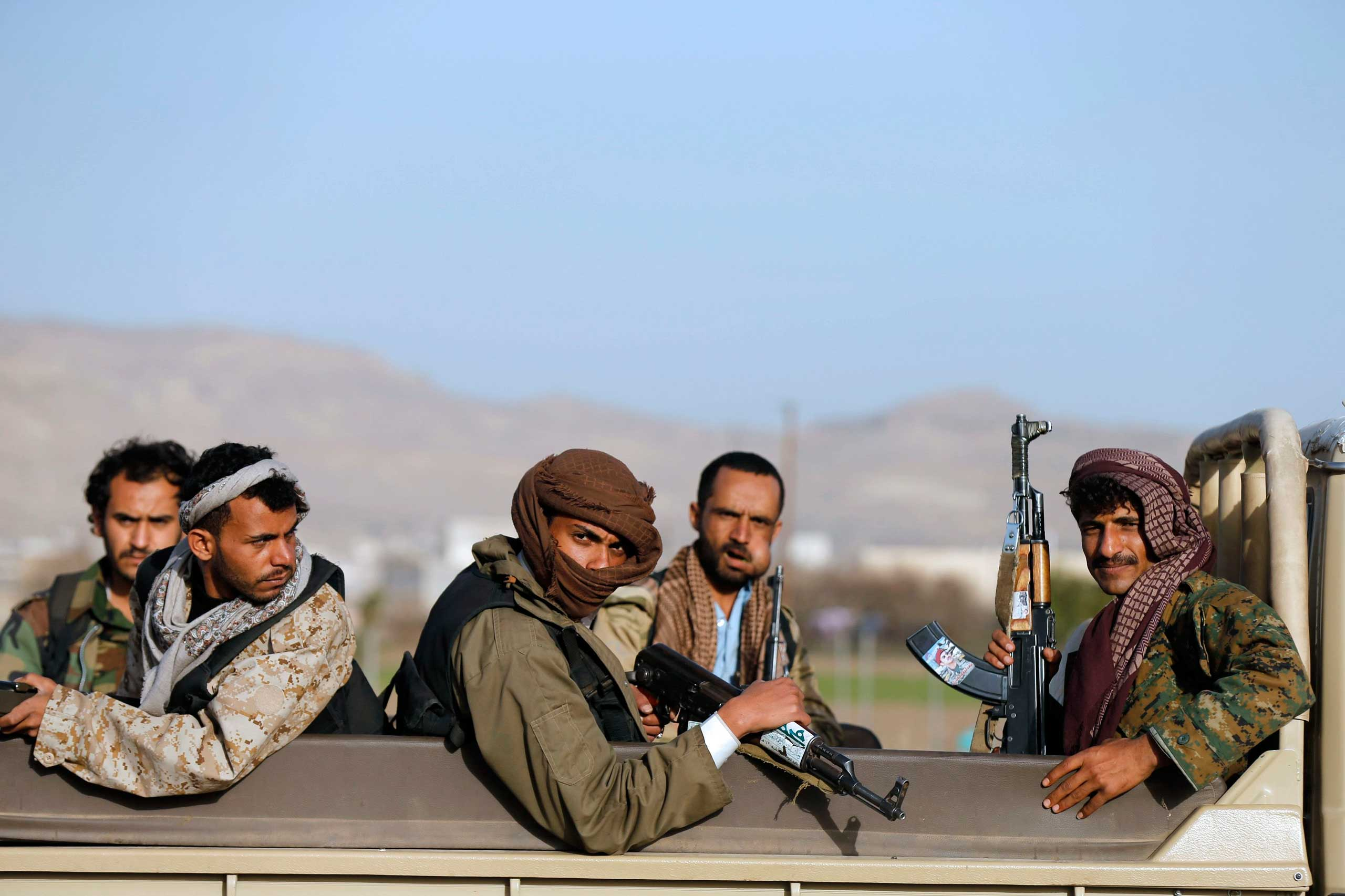Houthi fighters ride a truck near the presidential palace in Sanaa, Jan. 22. 2015.