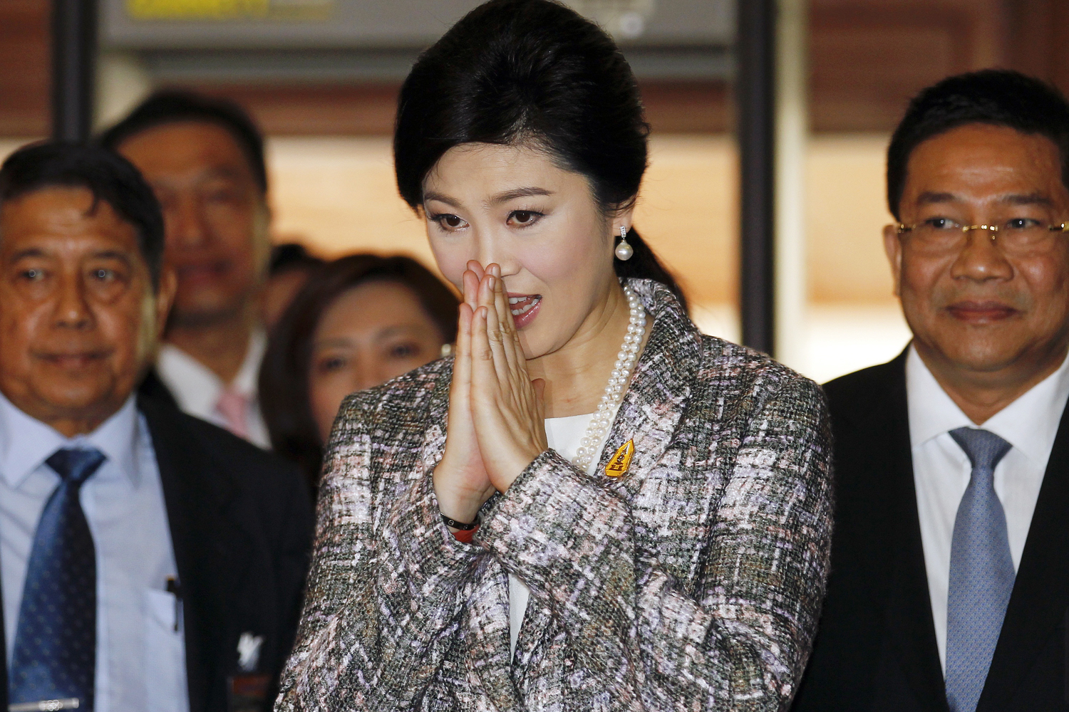 Ousted former Prime Minister Yingluck Shinawatra arrives at Parliament before the National Legislative Assembly meeting in Bangkok on Jan. 22, 2015