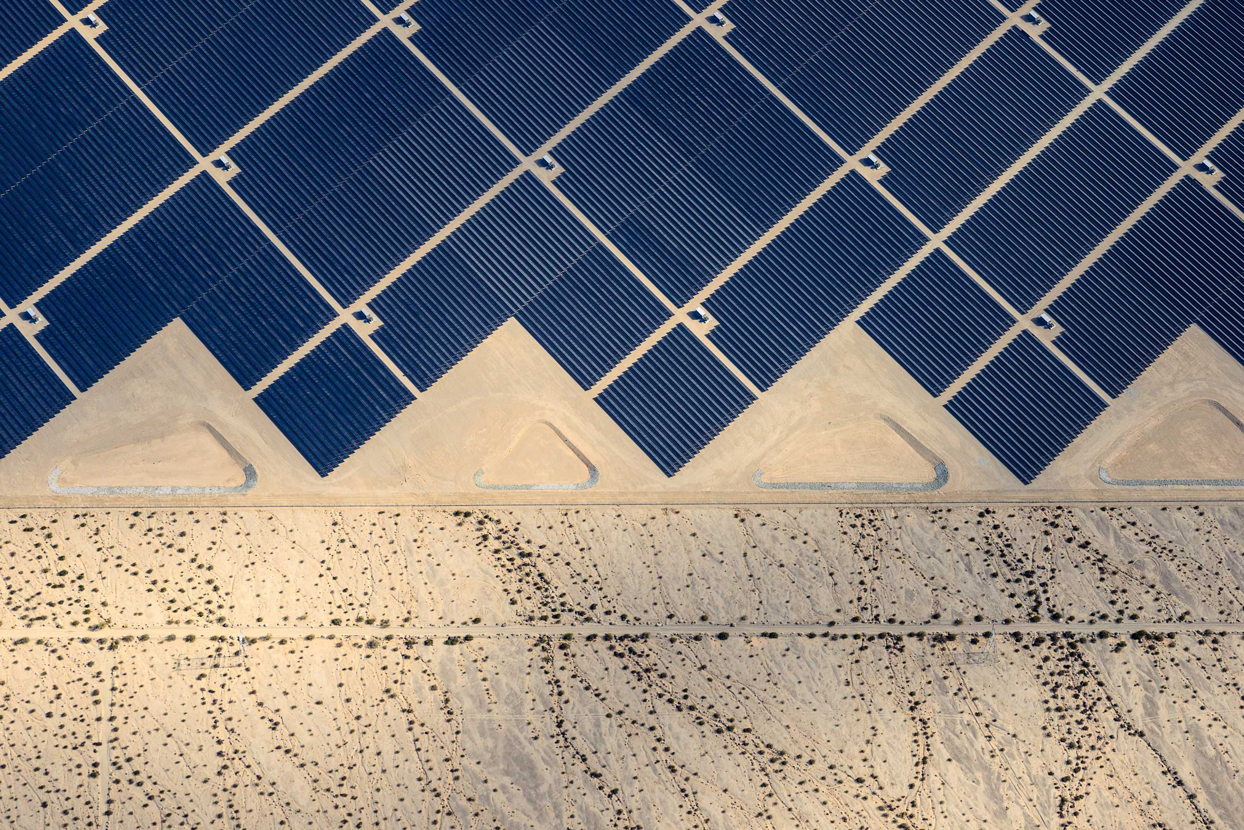 Desert Sunlight Solar Farm produces 550 megawatts of energy, equal to the output of a conventional power plant, near Palm Springs, Calif., where 8 million photovoltaic (PV) panels convert sunlight into electricity.