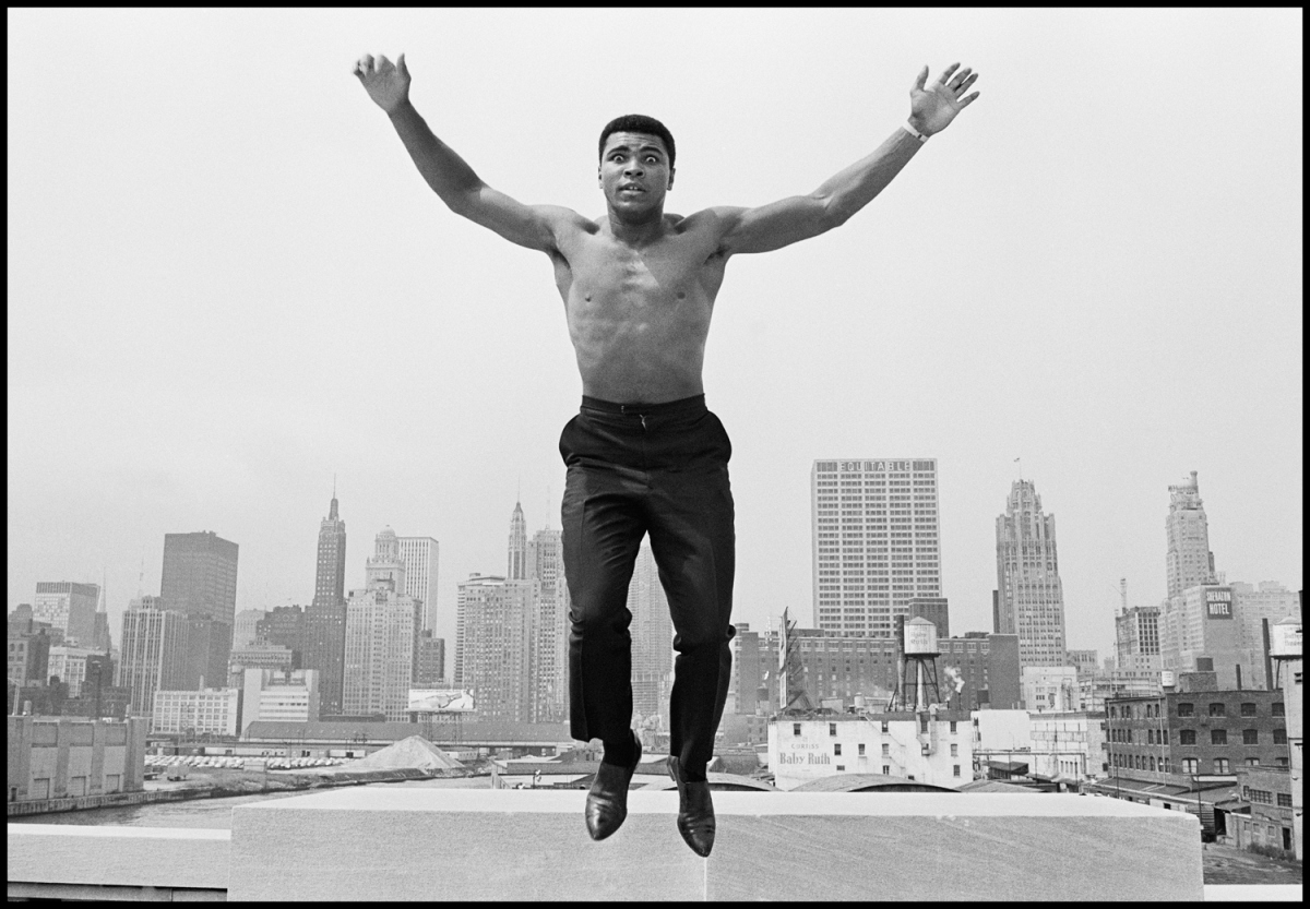 Ali jumping, Chicago, 1966                                Thomas Hoepker:  One day we drove over the Chicago River, when I remarked that this was a great view of the skyline. Muhammad stopped the car and got out. 'Could you please climb on that railing?' I asked. Ali jumped onto the banister, took his shirt off and shouted, 'I'm the greatest! Want me to jump?' A split second later I had my picture — just this one click, one chance — and we drove on.  Thomas Hoepker is a photographer represented by Magnum.