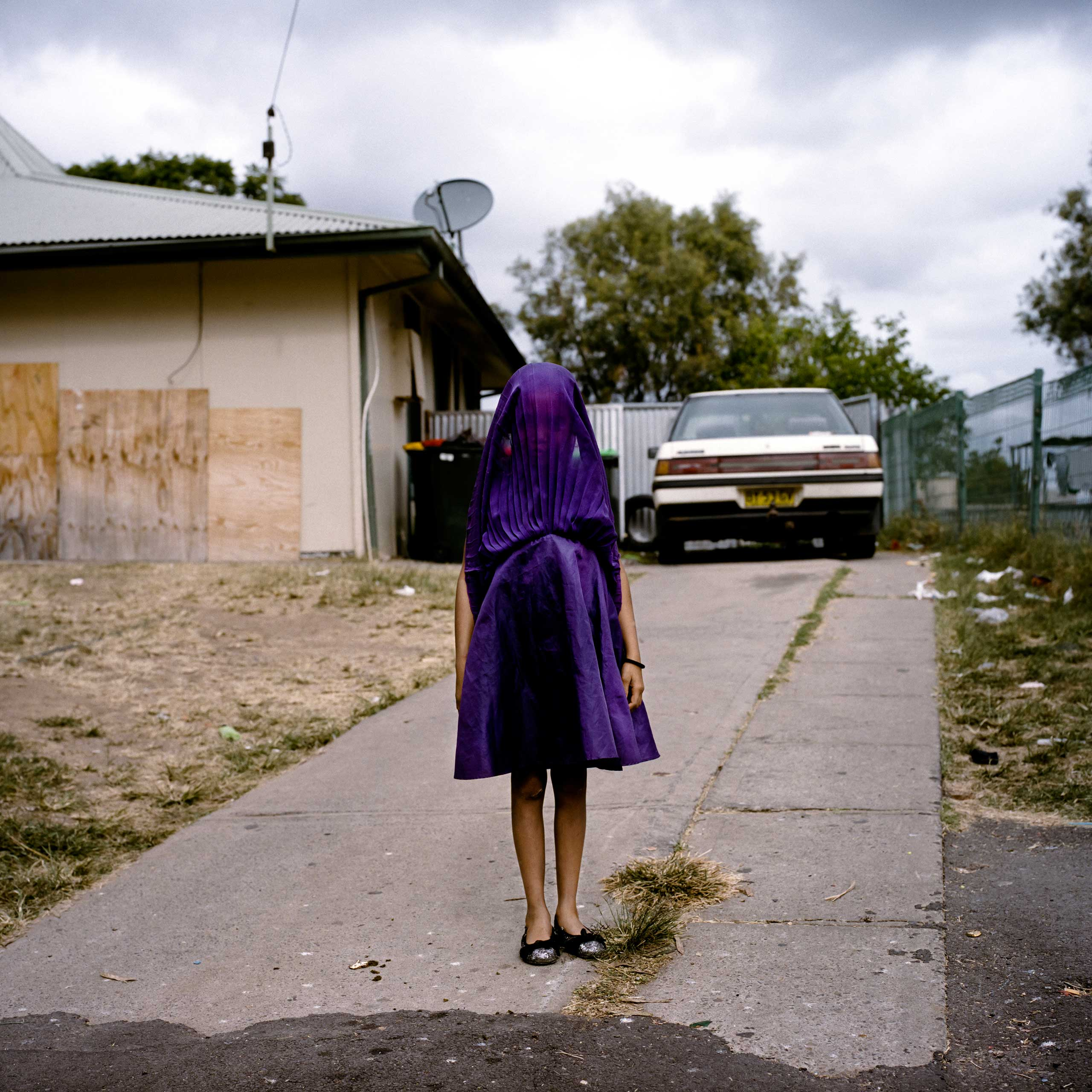 <b>First Prize Portraits Category, Singles</b>Laurinda waits in her purple dress for the bus that will take her to Sunday School, Moree, New South Wales, Australia.