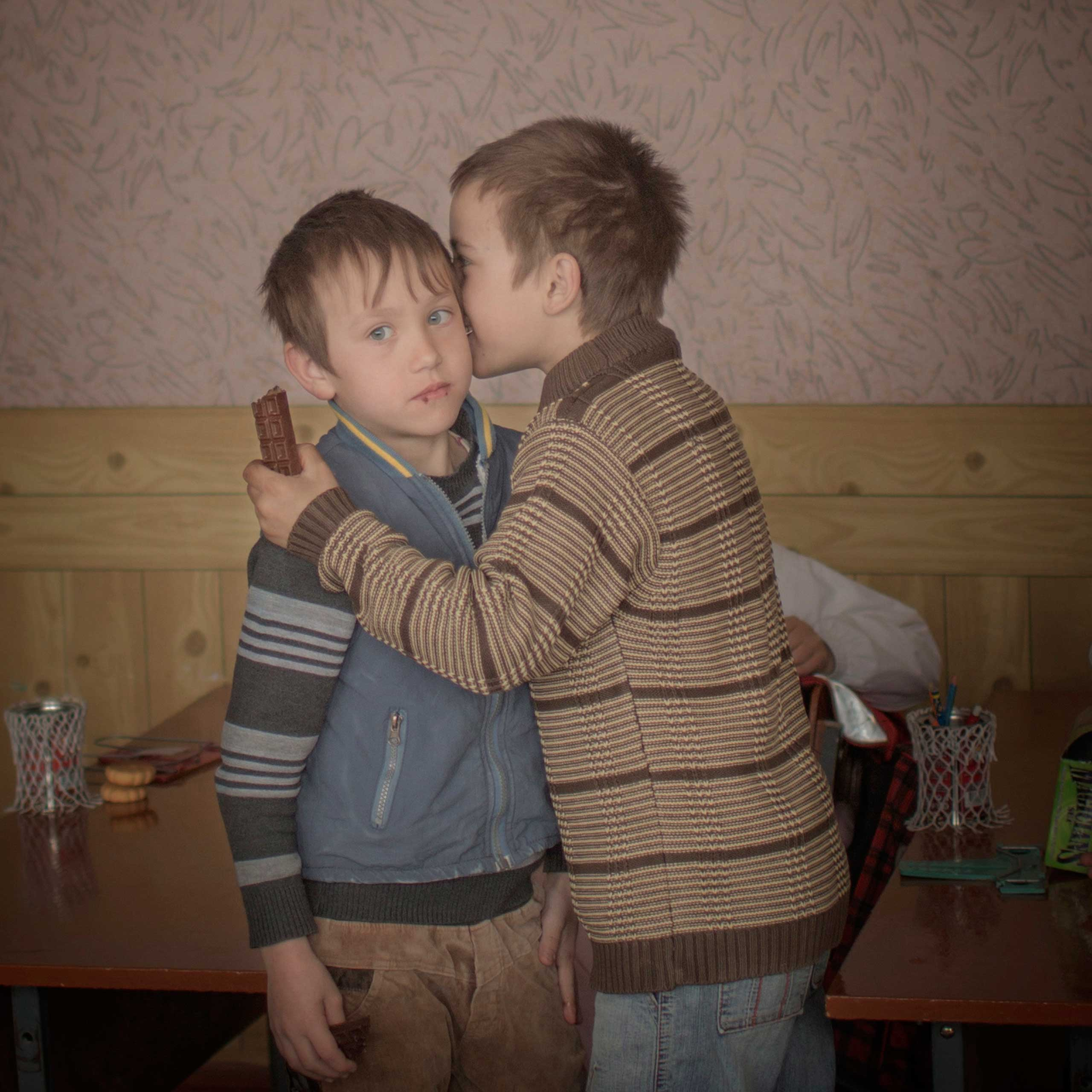 <b>Second Prize Daily Life Category, Singles</b>Twin brothers Igor and Arthur hand out chocolates to their classmates to celebrate their ninth birthday, Baroncea, Moldova.