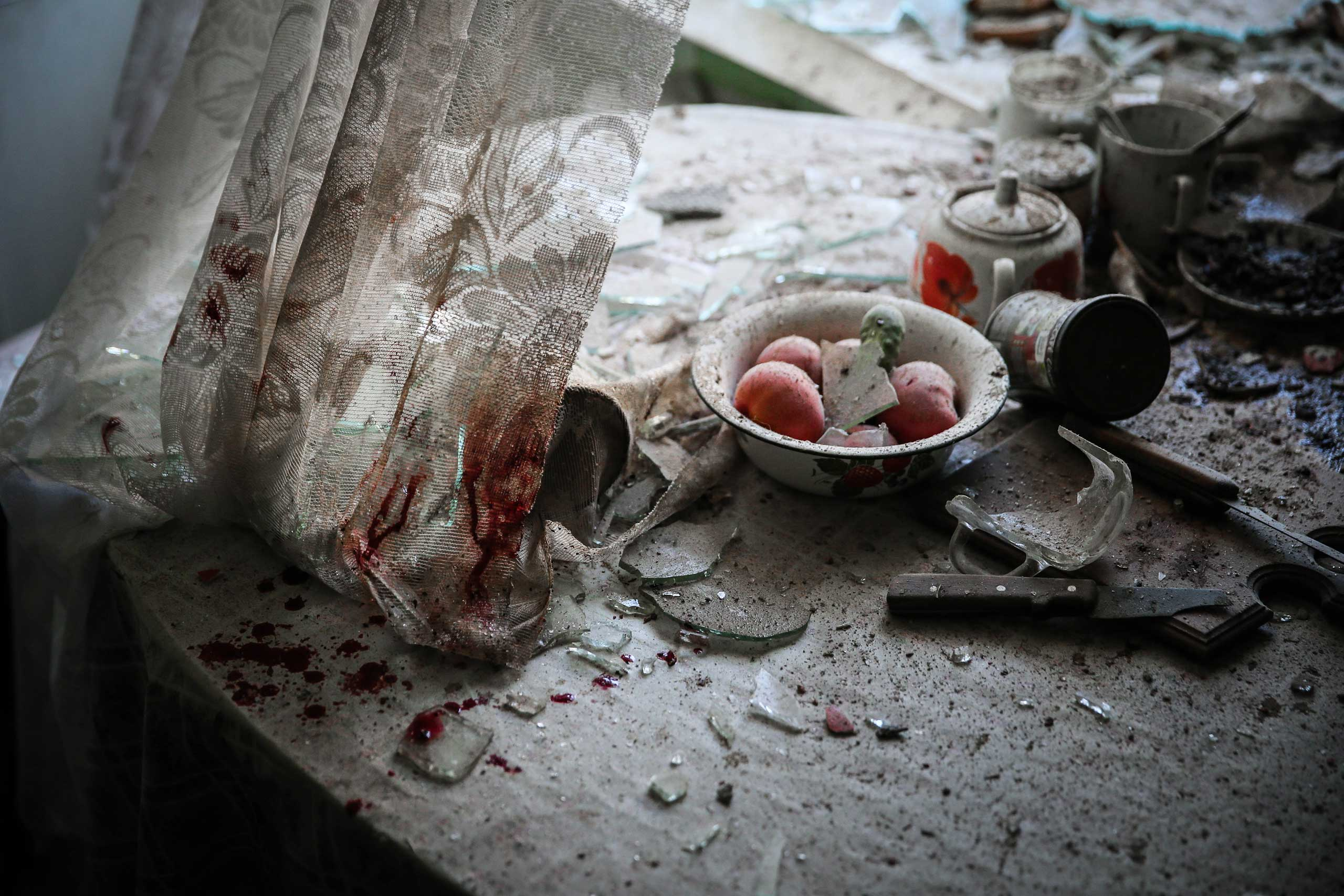 <b>First Prize General News Category, Singles</b>Damaged goods lie in a kitchen in downtown Donetsk, Ukraine.