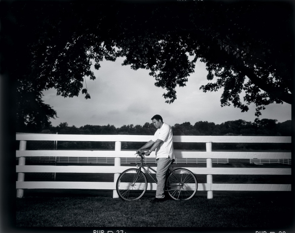 Ali's home, Berrien Springs, Mich., 1996                               Walter Iooss Jr.:  I wanted to do an Annie picture that day — Annie Leibovitz, that is. As we drove into his estate, the fence was the first thing to catch my eye, but I wasn't sure how to incorporate it into a photograph. Then Ali came out on a bike, and the image came together. Serendipity at its best.  Walter Iooss Jr. is a Sports Illustrated photographer.