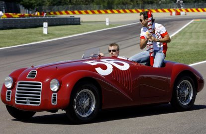 Ferrari Formula One driver Raikkonen of Finland and team mate Massa of Brazil during the celebration of Ferrari's 60th anniversary