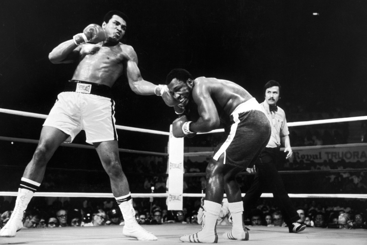 """Ali landing a shot on opponent Joe Frazier in Manila, 1975                               Manny Pacquiao: """"Growing up, I was aware of what the legendary Muhammad Ali achieved in and out of the ring. Filipinos have a special place in their hearts for Ali because his greatest win took place in the Philippines in 1975. Although I was not yet born when he fought the very best, I learned from watching his fights on television and the stories that I heard of how great he truly was during his prime. Nobody can doubt his achievements in the ring. He did not back away from any fight. There is no doubt that he influenced me as a fighter because of the things that he did inside and outside the ring. He is a classy competitor and, more important, a true human being. I can say that he had a hand in making me what I am today.                                Manny Pacquiao is the first eight-division world-champion boxer. He is also a Congressman in his native Philippines, where he is hailed as  the national fist."""