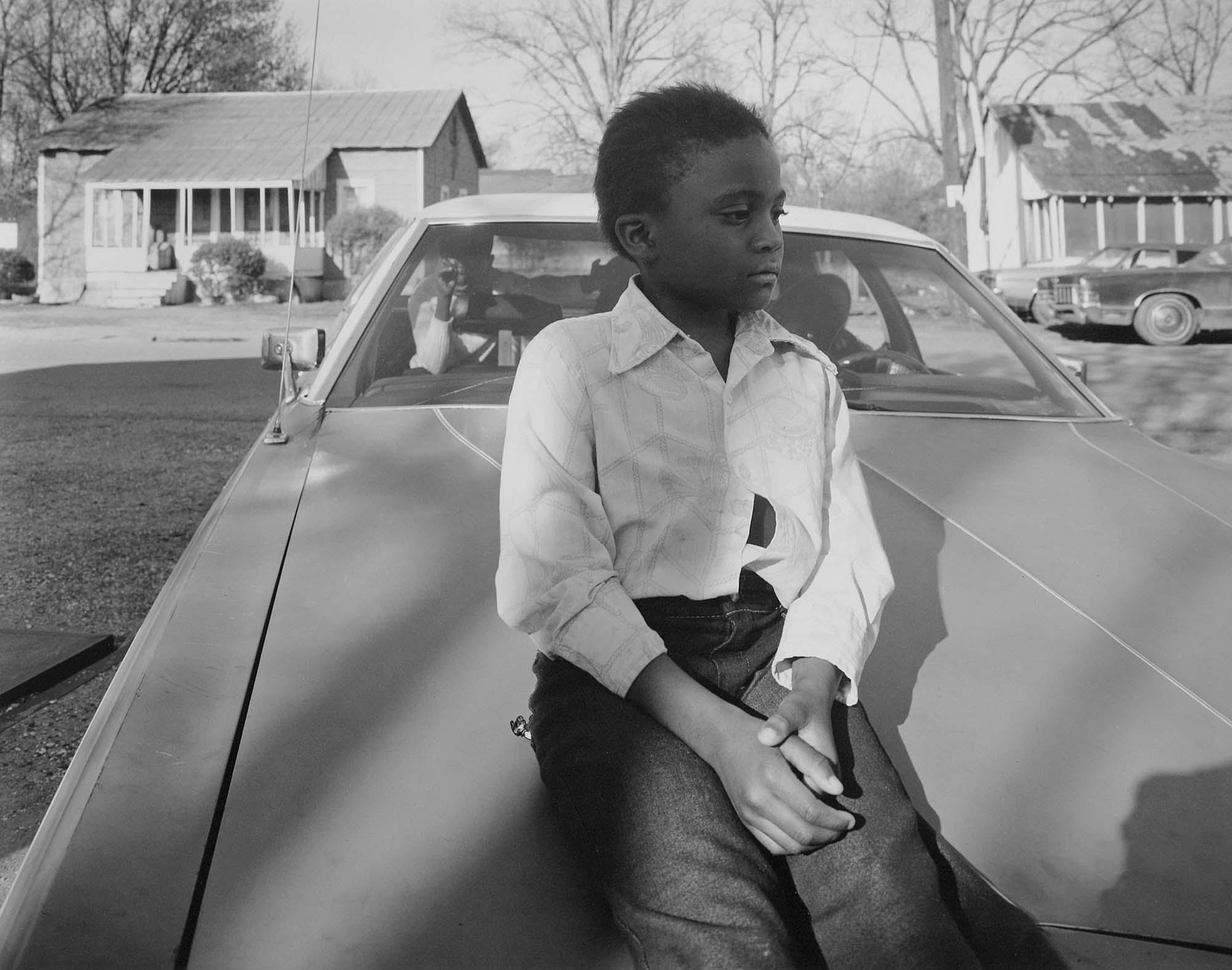 Child on hood, Hughes, Ark.,1984.